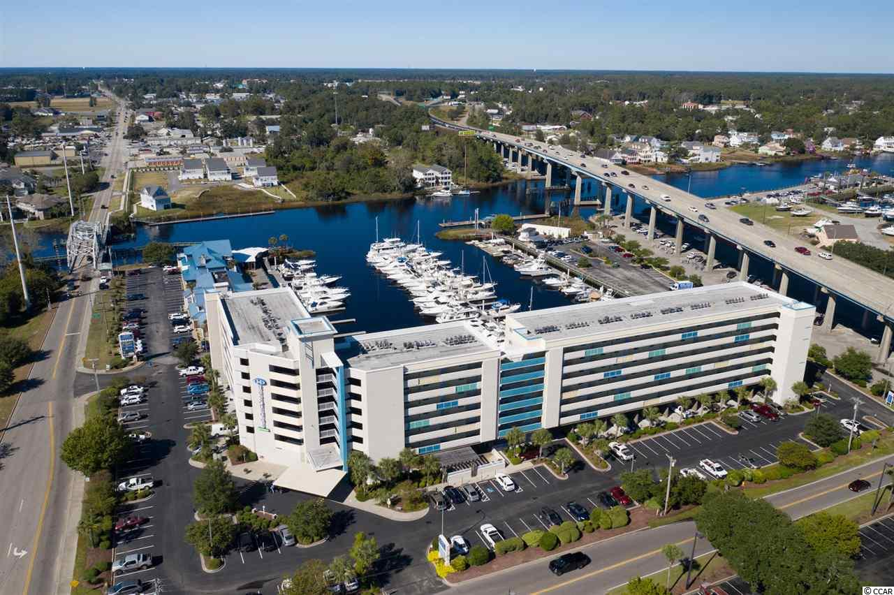 Million dollar views of the marina and Intercoastal Waterway!  Live the waterway life style.  This is a true one bedroom condo overlooks the Harbourgate Marina.  This condo boosts an open feel with views straight from the living room. A nice size balcony and open floor plan make this an incredible space. New HVAC (2018), new paint, updated appliances, all inclusive HOA, and partially furnished makes this condo perfect for a second, home, investment, or living life everyday as if you were on vacation.  Great location, walking distance to Filets Waterfront restaurant, and a short 6 minute drive to Cherry Grove Pier.