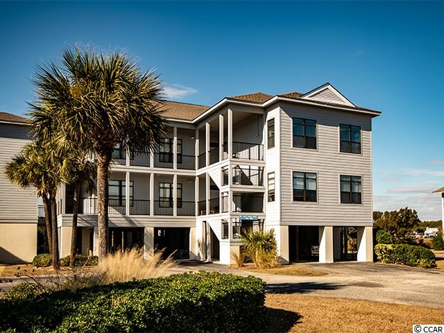 The best of both worlds! Across the street from the beach and direct creekfront views and access. This fully furnished 3 bedroom, 3 bath villa has been designed with all the comforts to truly enjoy the coastal lifestyle. An inviting foyer leads to the beautiful updated kitchen with breakfast bar and dining area. The spacious living room leads to a large screen porch that offers terrific view of the tidal salt creek. The large master bedroom has a lovely bright master bath and a screened porch for enjoying beautiful sunsets over the creek.  The two additional bedrooms have a view of the ocean. Just across the way is the large community pool and the walkway to the beach access. Directly behind the villa is a generous covered community dock with sitting areas and floating section for kayaking, boating, fishing, crabbing and all the creek fun you can stand! Plenty of storage downstairs for the beach chairs and sand toys. This villa invites family fun all year long.