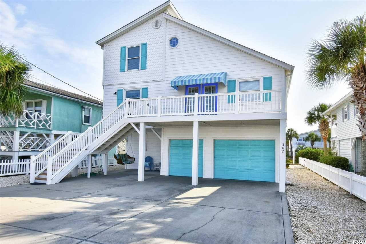 Welcome home to this fully furnished, 4 bedroom, 2 bathroom raised beach house on the channel in North Myrtle Beach. This home features a spacious open floor plan of the main living area with tall vaulted ceilings, wood laminate flooring and cozy carpets flowing throughout. The kitchen is equipped with all appliances, plenty of cabinet and counter space, and a dining area combined. Two bedrooms are on the main level, and two on the top level. Each bedroom includes a ceiling fan, plenty of closet space, and easy access to a bathroom. A den/second living room adds another entertaining space, along with a huge back deck overlooking the channel. The garage underneath the house will fit 2 cars and a golf cart comfortably, and also includes a large storage room. An elevator is available for even more added convenience. This home has been meticulously maintained and is ready for you to move in or start renting! Perfectly situated in the heart of North Myrtle Beach, close to all of the Grand Strand's finest dining, shopping, golf, and entertainment attractions, and just a short walk to the beach a few blocks away. Whether you are looking for your forever home or your next investment opportunity, you won't want to miss this. Schedule your showing today!