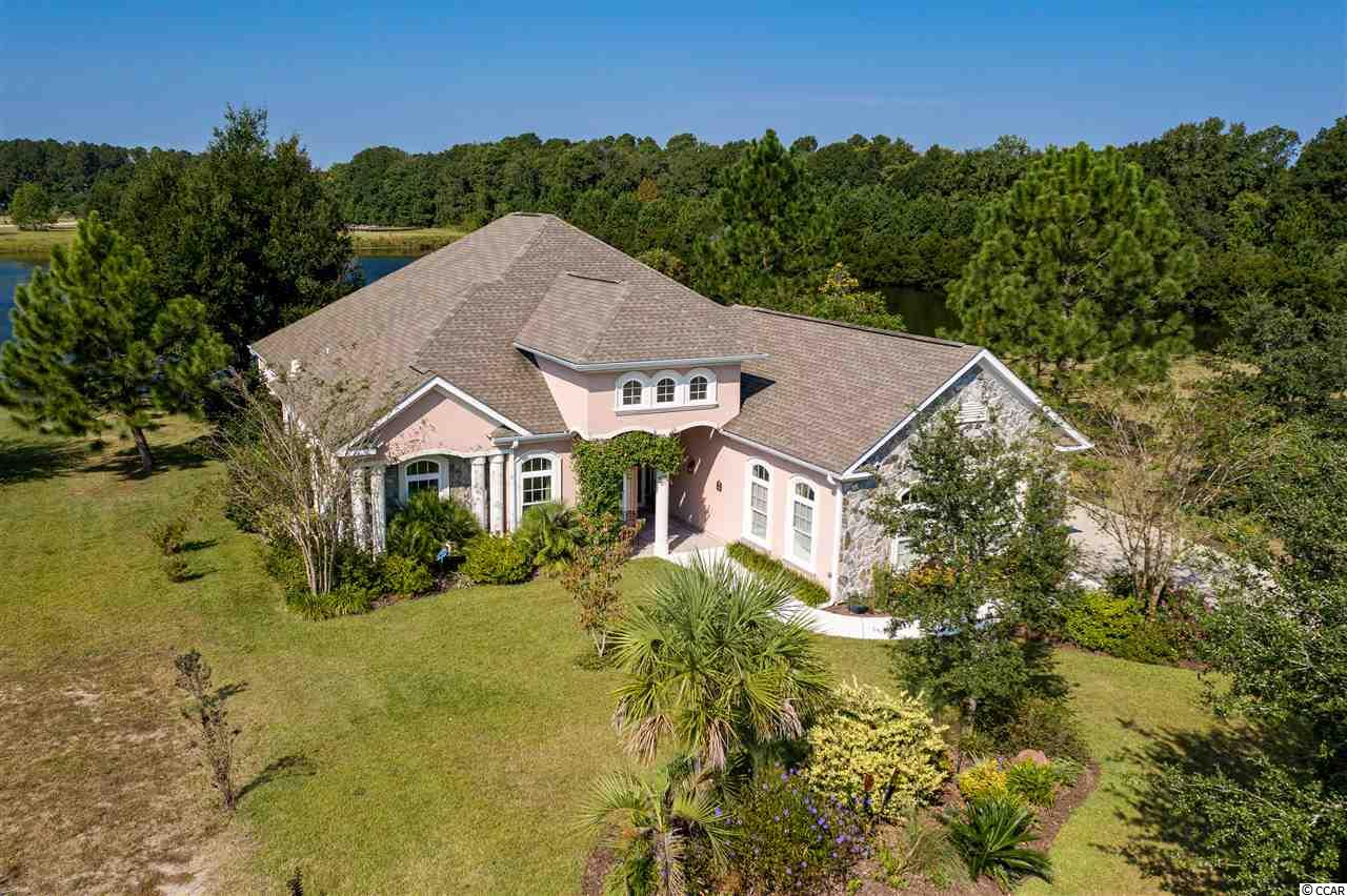 """Don't miss this stunning Wild Wing Plantation home with four bedrooms and three and a half baths. This energy-efficient home offers a three-car side load garage and gorgeous landscaping. Enjoy morning sunrises and sunsets from this stunning lake lot, also located on a cul de sac for privacy. Enclosed porch is where you will find yourself with an additional entrance from your master suite. Master bedroom with high volume tray ceiling with recessed lighting and bay window. His and hers closets and a master bath with enormous walk-in tiled shower, Jacuzzi tub, double sinks and two linen closets. A gorgeous custom built home lovingly maintained inside and out. High volume ceilings throughout, crown moldings with accent lighting, boat dock, gas fireplace, wood flooring, gourmet eat-in kitchen, stainless steel high-end appliances, granite counters, formal dining room and a den/office that can be used as a fifth bedroom if needed. All this in the fabulous Wild Wing Plantation Golf community with first-class amenities. Pools, gym, kiddie pools, hot tub and 180 acres of boatable lakes. Great location, convenient to schools, shopping, dining, attractions, airport, and highways. If you are looking for that """"WOW"""" home, your search has ended."""