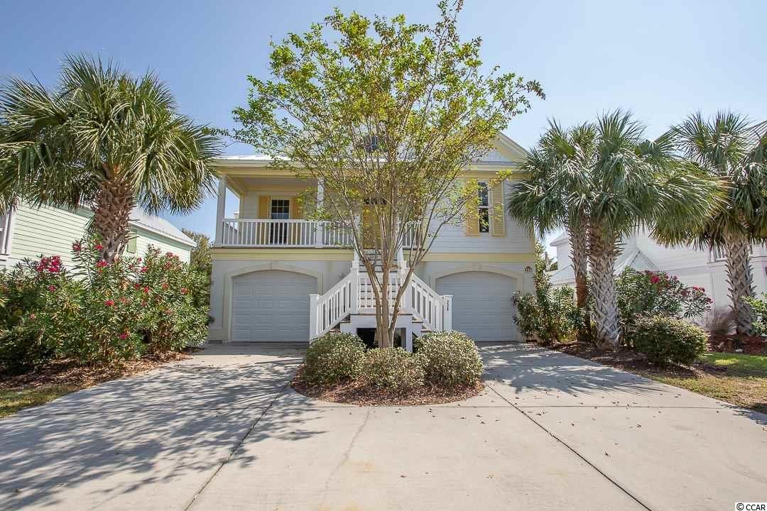 Spectacular 5BR-4.5BA raised beach home in Surfside Beach! A perfect beach get away large enough for the whole family! When not being used for personal use it is a great investment property. Well maintained and tastefully furnished. The first floor level is a separate living quarters with it's own entrance, kitchen, washer/dryer, 2 bedrooms and a large bathroom. Walking up the front steps to the large porch gives you a wonderful beach feeling. The main living area is a bright and airy open floor plan. The kitchen features a breakfast bar, pantry, solid counter tops, plenty of work space and cabinetry. The large master suite has a sitting area, a door the leads to a private balcony, an oversized bathroom with a double vanity and large walk-in shower. A second suite on the this level has two queen beds. A bonus room is located overlooking the living area, you will find a kids' room with bunkbeds, a twin bed and a sofa. Bermuda Bay has its own gated Beachfront Access!  Oceanside Village/Bermuda Bay amenities are 24 hour/gated/patrolled security, a community center, tennis, bocce ball, pickle ball, playground, dog park, and of course the pools; indoor heated & an outdoor pool complex featuring a splash park and two covered areas. Square footage is approximate and not guaranteed.  Buyer responsible for verification.