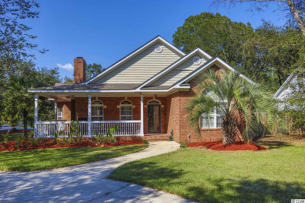 Incredible opportunity now available in the highly sought-after area in Murrells Inlet, Wacca Wache Estates.  This 4BR/4.5 Bath home sits on approximately one acre on corner lot with NO HOA!  This Low County style home has beautiful, reclaimed pine flooring throughout living area and boasts wood burning stone fireplace, vaulted ceiling, built in entertainment center, detached garage with living quarters above and more!  Kitchen offers work island with granite & stone, stainless steel appliances and work desk.  Large Master Bedroom has large walk in closet and Master Bath with oval jet tub, shower, double vanity and linen closet.  All other bedrooms have their own full bathroom.  This property offers multiple ways to entertain including large patios, firepit and Saltwater heated pool with 8' round hot tub.  Deep garage equipped with endless shelving and storage, workbench and wall AC unit for heating and cooling.  Above the garage are living quarters with Full bathroom & Closet with room for small kitchenette to be added if needed.  Other notable exterior features of the home include landscaping lighting, irrigation system, RV/Boat parking, corner lot, circular driveway and privacy fencing.  Wacca Wache Estates is well known for its location within walking distance of public boat landing and just a short drive to the Marsh Walk, beach, shopping and dining.  Make an Appointment today!