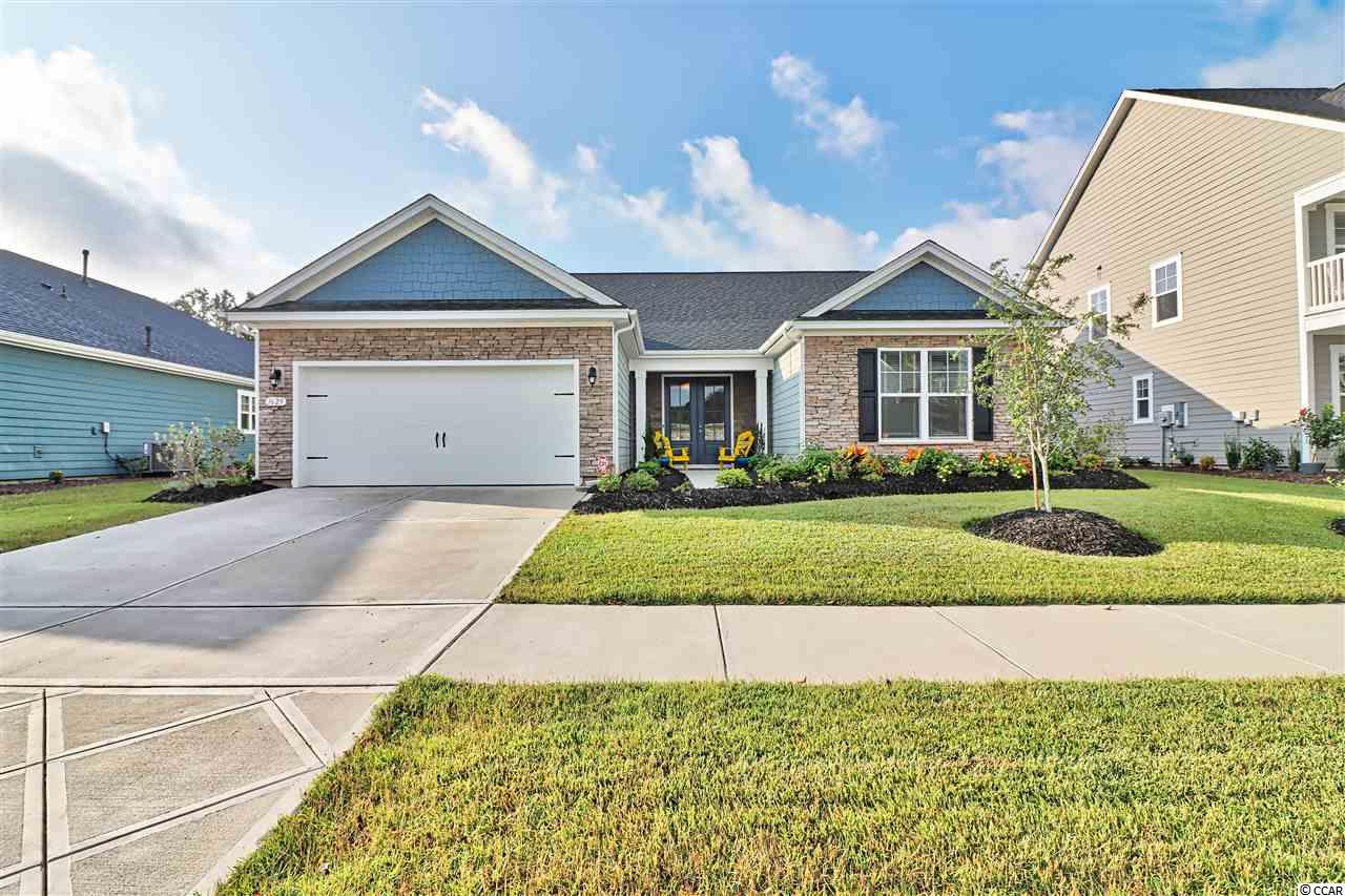 """Welcome home !! This is fabulous 3bedroom, 2.5 bath with dedicated office space purchased new in March 2018. This property is located in the prestigious West Lake at Montrose in Market Commons and shows like a model home. Outside of the house is brick and hardie plank. From the moment you enter this grand home, you will be greeted with spacious open floor plan which flows into living room and kitchen. Living room area has 11 ft. high ceilings and porcelain tile with half bath room.  Kitchen boasts large beautiful granite island, stainless steel appliances, with a natural gas cooktop, and 36"""" staggered cabinets. There is a breakfast area next to the kitchen. Across the kitchen is a very spacious dining room and dedicated office area. Large master bedroom with tray ceiling and crown molding and carpet. Master bath features double sinks, large oversized walk in closet and walk in shower. Other 2 bedrooms located across the living room are very spacious and share a full bath. Living room leads to screened in porch area and fenced backyard backing up to a wooded setting and path access. Kitchen area leads to 2 car garage.  Approximately, 1.5 mile to The Market Commons town center and 3 miles to the Atlantic Ocean. Just a golf cart ride away from everything you need."""