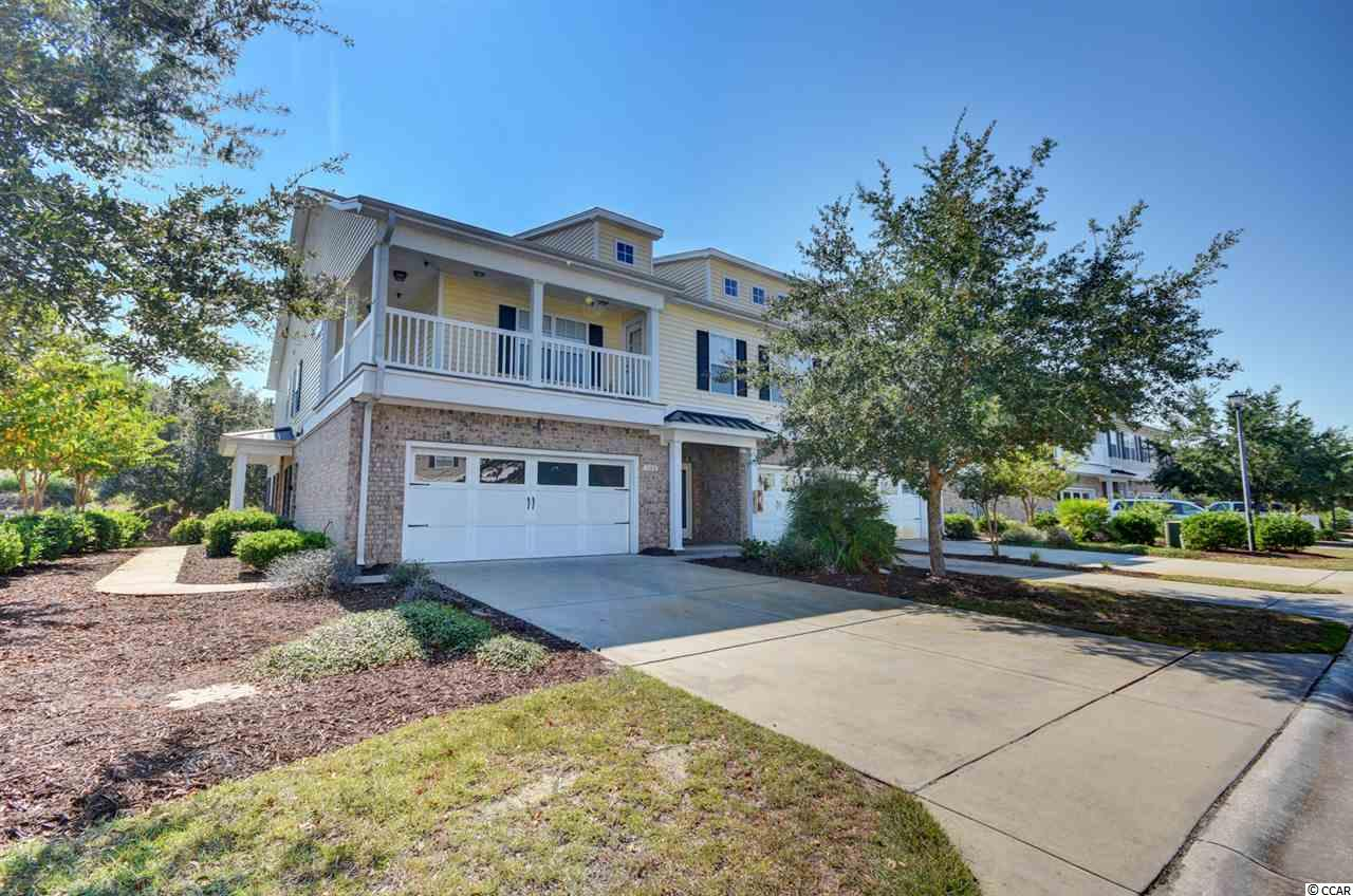 Beautiful 3 bedroom 2 and a half bathroom townhome located in The Farm. This townhome features hardwood floors in the spacious living and dining room area, corian countertops in the kitchen, and a 2-car garage. This corner unit also comes with a new HVAC system that was installed this year as well as a Dual Zone Smart Thermostat that allows room specific control for the upstairs bedrooms. The Farm in Carolina Forest has endless amenities for its' owners and guests. You can take a dip in one of the pools, let the kids enjoy the playground area, work out in the fitness room, or relax in the clubhouse for a get together. You are just minutes from the best beaches, shopping, dining, and entertainment the Grand Strand has to Offer! Come by and see this townhome today!