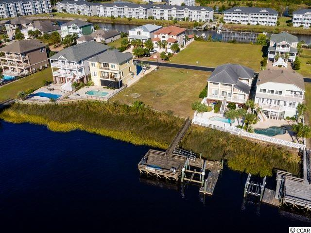 Breathtaking lot that sits directly on the Intracoastal Waterway! This lot is one of the few lots in Paradise Island that have a dock included with the lot price! Flat lot, ready to be build on with about 50  feet of bulkhead on the ICW. Don't miss the opportunity to build your dream home and buy the boat you have always wanted, sit on your balcony or dock and enjoy watching the boats going by. Close to everything the Grand Strand has to offer restaurants, shopping, entertainment and golf. This is a great location for water, boat and/or beach lovers and it's only about 4 miles drive to the oceanfront. Paradise Island is a gated community beautifully landscaped with upscale homes situated in Little River, just across the waterway from North Myrtle Beach.