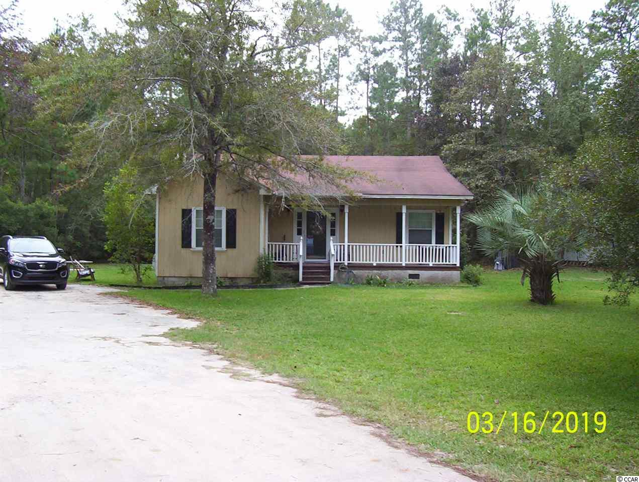 """VERY NICE 4BR LOW COUNTRY HOUSE SURROUNDED BY PEACEFUL FOREST, OVER 1-ACRE LOT, SUNKEN LIVING ROOM, WASHER/DRYER, LARGE FRONT PORCH, LARGE REAR DECK, SEE THE DEER RUN WILD, NO FLOODING, NO FLOOD ZONE, HWY. 57 IS CRAZY WITH NEW CONSTRUCTION, THERE IS NOT ANOTHER HOUSE IN THIS PRIVATE LOCATION OR LAND SIZE AT THIS PRICE, OWNER FINANCING, OWNER HAS JUST GREATLY REDUCED THE PRICE, """"AS IS, WHERE IS"""", OWNER/BROKER!!!!!"""