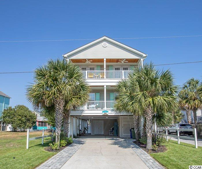 Spectacular 5BR-3.5BA raised beach home with private pool only 150 steps to the ocean in Surfside Beach! This home has everything you could want! A balcony off every bedroom with view, downstairs master suite & 4 bedrooms upstairs. The master en-suite has custom built-ins in the master closet and a beautifully remodeled bathroom, 2019. The half bath on this floor has been recently remodeled too! Amazing chef kitchen totally remodeled in 2019 with stainless steel appliances, granite counter-tops and custom cabinets. Luxury vinyl plank flooring installed throughout the entire first floor in 2019. Special features include: elevator to all 3 floors, central vacuum, 3 full balconies with new wainscot ceilings & one-half balcony, outdoor shower, 1/2 bath in workshop area & tool room, carport ceiling newly painted,  12'x24' private pool, six foot privacy fencing, pool & deck resurfaced 2016, detached pool house with shutters.  NO HOA!!  Roof & second floor HVAC replaced in 2016. Just a walk across the street to the beach. WOW!