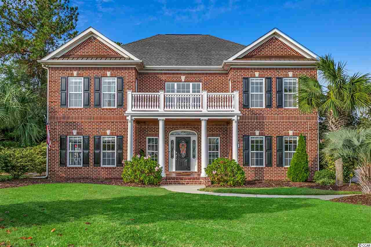Looking for a large family home? Look no further, this beautiful all brick custom home is located in the highly desired neighborhood of Plantation Lakes. Plantation Lakes is an upscale community in the award winning Carolina Forest School District.  This 5 Bedroom, 3 full and 2 half bath home sits on a quiet, cul-de-sac lot.  From the minute you walk in, you will notice the 2 story soaring ceilings in the foyer and family room. This home offers all tile and hardwood flooring throughout the entire house.  The beautiful custom kitchen, has granite countertops and top of the line cabinetry & appliances, tile back and a sit up counter height island which is all open to a two story family room with a gorgeous stone accent wall.  The master bedroom is on the first floor and the upstairs has 4 oversized bedrooms with jack and jill bathrooms connecting them, giving every bedroom their own private sink area.  The 2nd story also has an all seasons porch over looking the in-ground pool, hot tub and lake.  The bonus/entertainment room has its own built in bar and is large enough to hold a pool table, foosball table,  make it a 2nd living room or anything you want. There is 2nd staircase from the bonus that leads to the kitchen. The backyard retreat is to die for, pool, jacuzzi built in outdoor kitchen, boat dock... There are too many special features to mention!  Call today to schedule a showing!  Don't hesitate this home will not last!!