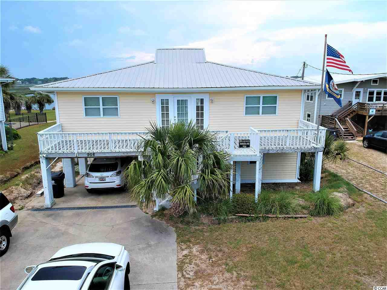 Just Reduced! Enjoy the best of both worlds from this 5 BR (6th BR easily possible by converting office) and 3.5 Bath channel front home on large lot, actually two (2) lots, located directly across the street from the beach and ocean. Features include hardwood floors, large lot with boat ramp, stationary dock, floating dock and boat lift. Two (2) lots platted and two Georgetown County tax parcels. The house is completely on the front lot which is 60' X 130' x 60' x 129.90'. This makes it easy to be able to sell either parcel independent of the other. The creek front lot is 60.20' x 96.10' x 60' x 91'. Seller will not subdivide, however, nor sell separately.