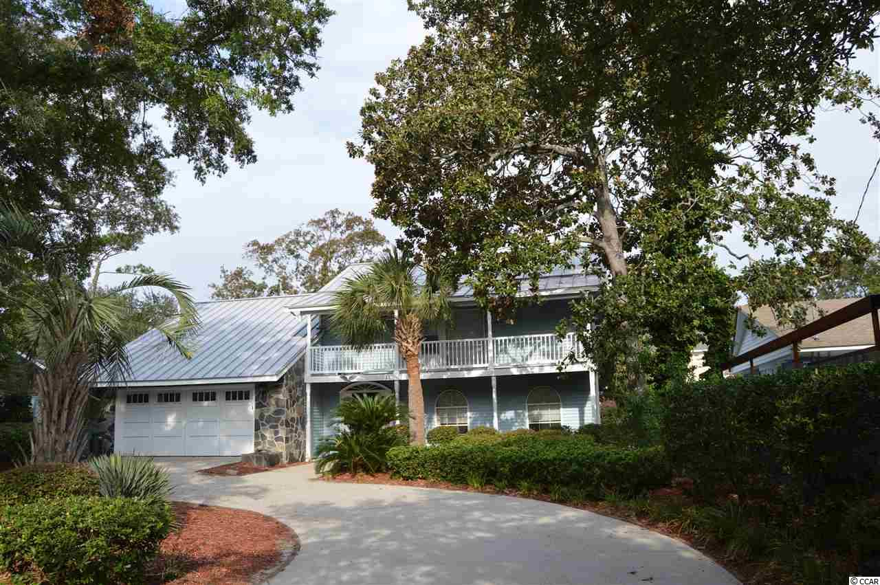 LOCATION, LOCATION, LOCATION!  Super Home located in desirable Forest Dunes.  2 master suites with one up and one down.  Located just a 3 minute walk from beach! Metal roof and artificial turf in the last year make this property almost maintenance free!  Plenty of room in the back yard to add a pool.  Plenty of storage in floored attic space.  Garage set up for heating and a/c if wanted.  Large screened porch in the backyard and decks on first and second floor.  House is ready for the next happy home owner!