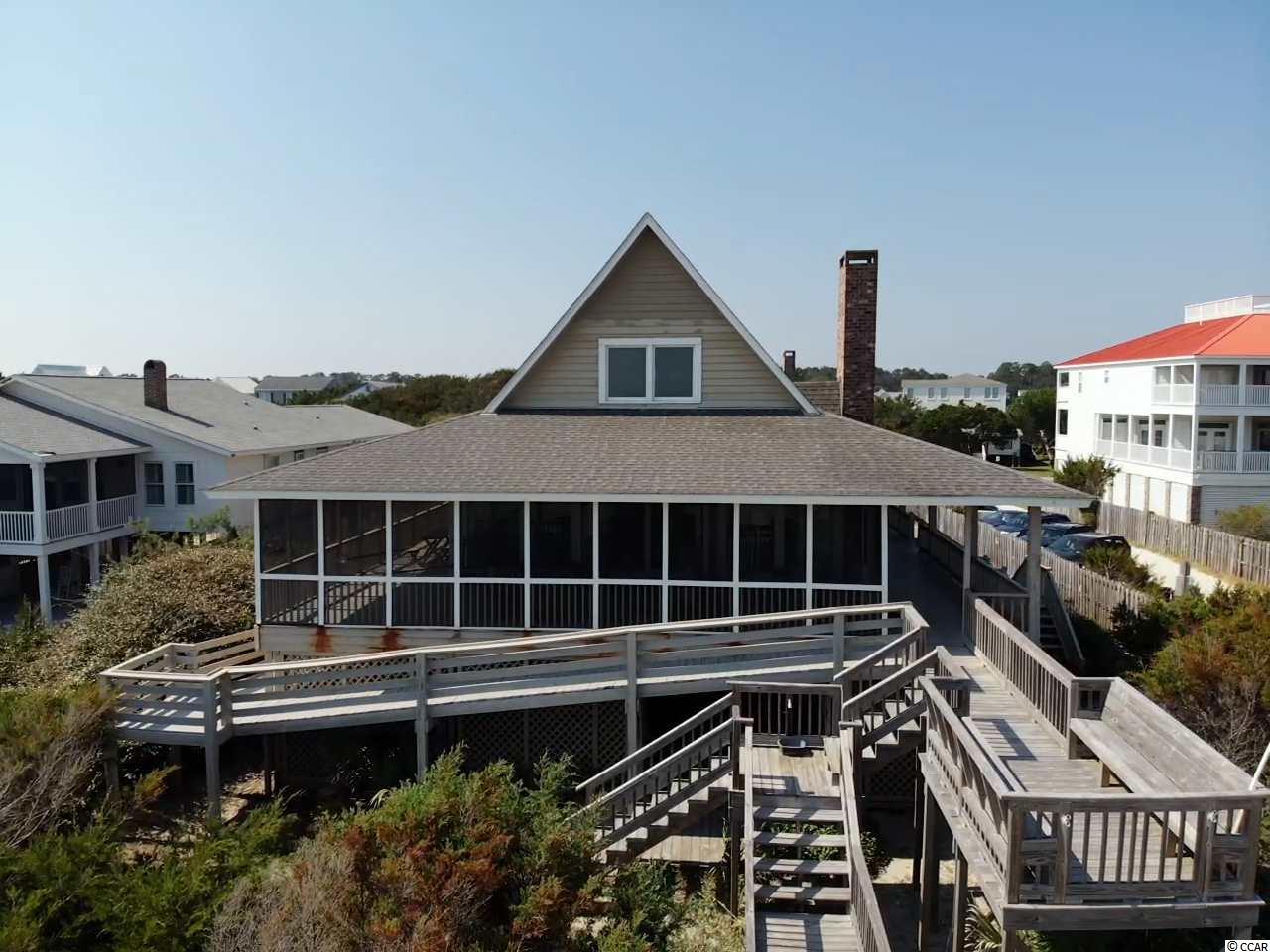 "Don't miss this rare opportunity to own your piece of heaven in Pawleys Island and enjoy all the beauty of the wonderful low country seasons in this 4-week interval ownership home located ocean front on the north end of the island. Grayman II is one of the only 4 homes on Pawleys grandfathered to allow interval ownership with each of the 13 intervals having deeded ownership and exclusive use of the home for one week each quarter. The occupancy schedule rotates on a yearly basis to ensure equitable usage to all owners. The home is professionally managed and cleaned by a maid service weekly at the end of each stay. With 4 bedrooms and 3 baths the home comfortably sleeps 10. Master suite with king bed is located on the main living area with two other bedrooms and features stunning views of the ocean and includes private access to the screen porch. Stairs in living area lead up to the 4th bedroom with queen bed, daybed and private bath.  Owners of Grayman II enjoy a large open living area with spectacular views of the Atlantic Ocean featuring a cathedral and beam ceiling in main living area and a wood burning fireplace. The kitchen is open to living and dining area with stainless steel appliances and granite counter tops. All the living areas open up onto very large wrap around screen porch for extra living space and entertaining. This essential ocean front screened porch is the heart and soul of Grayman II and the Pawleys Island life style; perfect for rocking in the morning with a cup of coffee, for grabbing a book or a nap in the hammock, for hosting candlelight dinners at the outside dinning table; this spacious screen porch will likely be your favorite ""room in the house"". Interval Ownership at Grayman II is all about good times and easy living; so pack up your beach clothes and flip flops and enjoy the best in beach living at Pawleys Island; close to area restaurants, night life, shopping, and championship golf courses. The attractions of Myrtle Beach and airport are 20 miles north and the Historic city of Charleston is 60 miles south. Don't miss this chance to live all the charmed beach life of historic Pawleys Island at a fraction of the cost. All dimensions and HOA info should be verified by the Buyer."