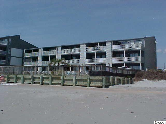 """Rare dog friendly partnership. Owners may rent their unused weeks.   There are 5 - 4 week shares available, one week per season each.  Call listing agent for schedules  Oceanfront comfort, no crowds, big pool, small complex.  If you don't like crowded pool or beach, limited parking, traffic, read on. If you prefer a full unobstructed view of the beach (and the pool) and want a beach vacation experience inside and out, this is your vacation home. If you need space for your motorcycle, trailer, golf cart, extra car, look no further, you have found your vacation home! Small dog friendly  This two bedroom oceanfront condo is one of only 15 units, but the pool is as big as many high rise buildings. All your vacation days begin and end with a perfect view of golden sand, blue sky and the soothing sound of the ocean waves.   The open floor plan lets the whole family enjoy the view whether on the large full width balcony, in the living room, or kitchen. Comfortable furnishings are ready for rest after days of activity, delightful decor keeps the """"beach vacation"""" spirit in every day. The master bedroom a Queen sized bed, flat screen TV and its' own sliding door to the balcony. The second bedroom has two single beds, TV and direct access to a full bathroom. The sofa converts to a queen size bed. Ceiling fans keep air moving in every room. There is high speed internet with WiFi access, the connection is specific to this condo, so you have security for any internet business during your stay. The fully equipped kitchen includes a full size refrigerator, stove with oven, microwave, toaster, small appliances, plenty of cookware. Lots of dishes, glassware and tableware are on hand.  Garden City is perfect for a family vacation or romantic getaway, away from the traffic and crowds, but still a short drive to attractions and over 100 golf courses. The Garden City Beach pier, restaurants and shops are less than a mile south from Mariners Watch. The popular Conch Cafe ocean side restau"""