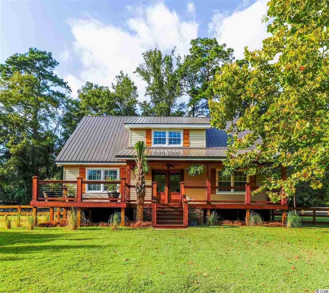 """Beautifully remodeled 55 acre Estate with top of the line finishes. 10 mins to waterfront Calabash, NC or Little River, SC. 17 mins to catching waves at Cherry Grove Beach or Sunset Beach. Huge Porch and deck across the entire front of this beautiful home surrounded by Cedar and stainless railing. Metal Roof. Hardwood tile adorns the entire first floor for durability and style. Granite and Marble Baths with a stunning master suite that encompasses the entire second floor. Free standing 2 person tub and tiled shower with multiple shower heads and frame-less shower enclosure. Media room and tray ceiling. Walk in closet. Home office nook with a view! Huge kitchen with 11' granite island, high end 42"""" cabinets with soft close, spice racks, built-in trash cans, glass cabinets, Farmhouse sink, etc. Kitchen overlooks the expansive great room with full brick wood burning fireplace. Additional two bedrooms on main and full bathroom with walk-in shower/seat. Screened porch leads to fenced yard and RV carport as well as a shop, outdoor sink, and additional 2 covered parking spots. This property has many uses. A stunning private horse farm, for crops, hunting, or for development. City water is available at end of driveway. Grapes, Figs, Blueberries, Turkey, and deer abound. 4 cleared pastures lined with Live Oaks and Spanish Moss. Pasture Fenced with electric to keep in cows, goats, and horses. Complete with automatic waterers. Backs to thousands of acres of undisturbed forests of the Waccamaw River Heritage Preserve for ultimate privacy. Public River access approximately 1 mile. You can't see your neighbors! Come see this stunning home designed and owned by a Realtor/New Home Builder as her personal home. 1 year home warranty included! (3 adjoining parcels total approx 54.78 acres). Sqft is approximate buyer is responsible for verification."""
