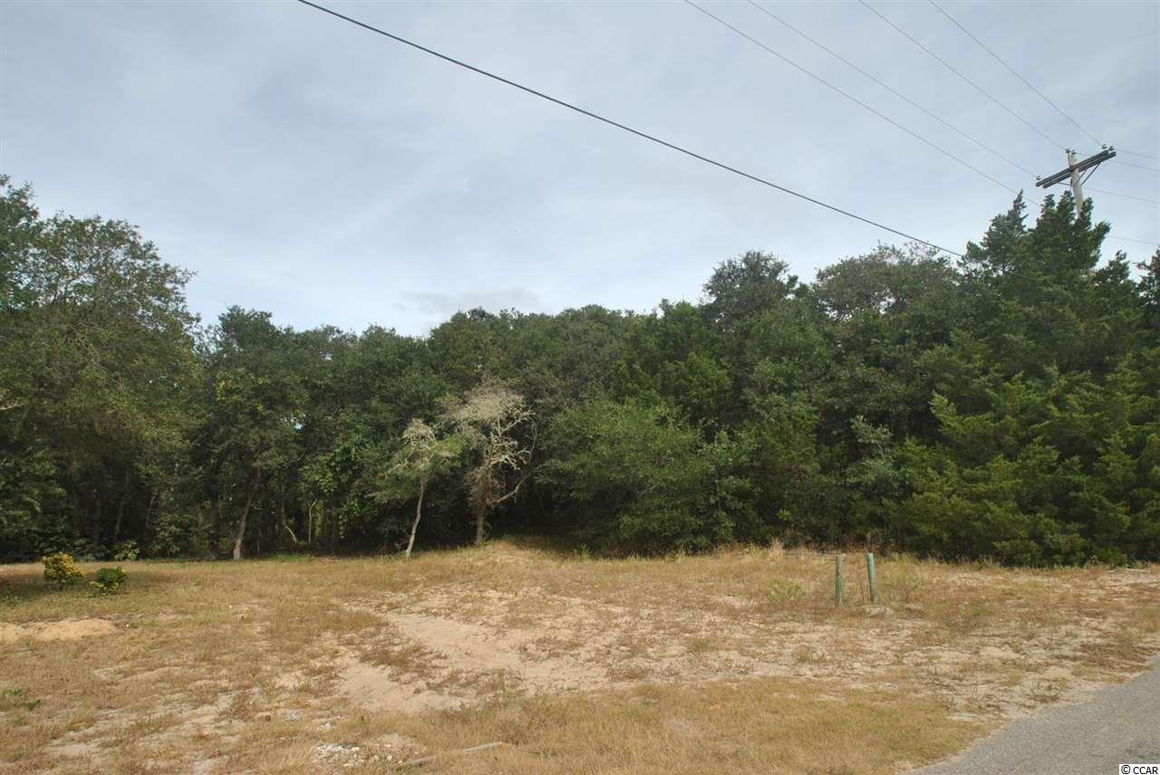 This beautiful building site in North Myrtle Beach is just 2 blocks from the beach (some ocean view likely depending on home design) and backs up to Ingram Dunes Park, a 7+ acre natural preserve owned by the city of North Myrtle Beach. Plenty of room to build on the .27 acre site. Great privacy. This property is NOT in a designated flood zone. No HOA. No mandatory start date for construction. Buy now- build later.