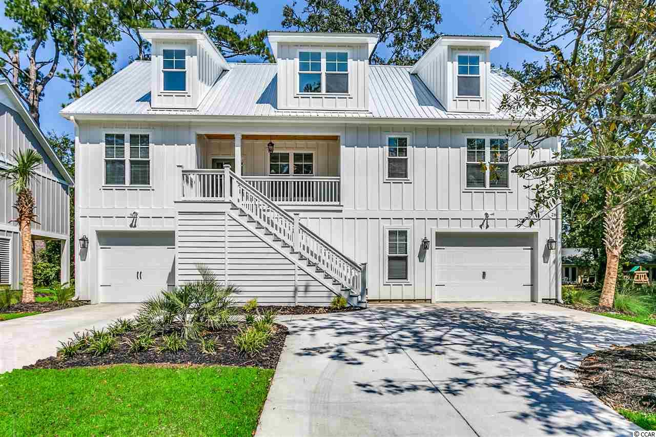 This raised BRAND NEW beach style home offers 4 bedrooms, 3 baths and an Upgraded flooring package to include Hardwood Floors, Ceramic Tile & Carpet. this home is just a short car ride from the Murrells Inlet Marsh Walk. Parking and plenty of storage underneath and a beautifully landscaped yard. Call Today!