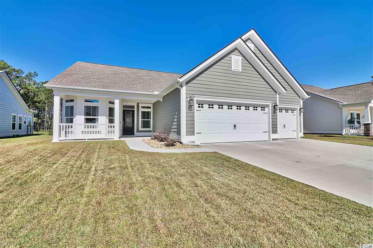 """Welcome Home! You must see this 3 Bedroom, 2 Bath, 3 CAR GARAGE home built in 2018! Enjoy your large backyard overlooking the pond. Located in the community of Belle Harbor nestled in the pristine community of Market Commons. Only a short Golf Cart Ride to the beach, shopping, dining and entertainment! As you enter the home you are greeted by a bright and welcoming space. This residence offers a spacious living area, formal dining room, office space, an open Kitchen with breakfast nook. The Master bedroom offers large His/Her closets along with a master bath double vanity, tub and shower! Wood Laminate Flooring and Granite Throughout, Stainless Steel Appliances, Gas Range, Updated Cabinets, Large Pantry, Covered Patio + Beautiful Stone Grilling Area, and A """"Smart Home"""" Feature. The property has been well maintained with many additions including: Blinds & Ceiling Fans throughout, Patio with Pavers, Custom Grill, Irrigation System, Insulated Garage Attic with an addition of pull down stairs, Laundry room & Garage Shelving, Under-Counter Lighting, Painted Garage and Gutters! Sit and relax on your big front porch or enjoy the fabulous patio while grilling out! You will love the Belle Harbor lifestyle and amenities!"""