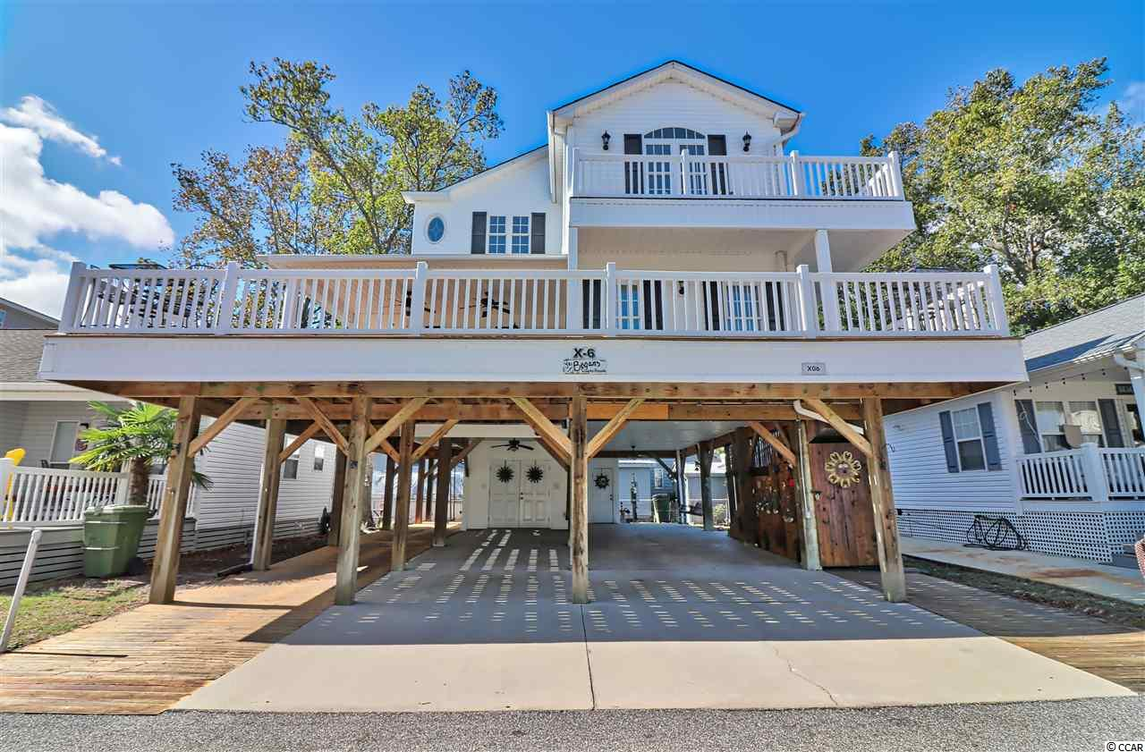 Look no further than this beautiful 5 bedroom and 3.5 bath fully furnished home in the award winning Ocean Lakes. This home has way too many features to list but we will give it a try. The flooring is vinyl throughout for easy cleaning and all windows are double hung and have been treated with protective film. The master bedroom is located downstairs and has an adjustable split king size bed with specialty Jamison mattresses. The master bath has a shower, double vanity and large walk in closet. The kitchen has all Whirlpool appliances and all small appliances will be included. There is also a Osmosis water filtering machine. You will also find an elevator on the back of home if needed that will take you from the ground level to first floor. There are 2 HVAC systems and both were installed in June of 2018. The over sized decking is endless with a very large covered side and front deck. The second floor balcony gives an amazing view of Ocean Lakes Drive and a view of Sandlapper Lake along with serving as a cover for the entry steps. All decking has been stained recently with Super Deck Stain. There is an outdoor shower with hot and cold water, attached storage shed for beach belongings and golf cart. Oh yes, the golf cart is included too. Did I mention the Traeger Smoker Grill and Ducane Grill are also in the deal? You will only need to bring your toothbrush and you will be ready to go. Are you familiar with Ocean Lakes? Ocean Lakes is a 300 acre ocean front complex with 24 hour security. You are sure to love all of the amenities that Ocean Lakes has to offer. Some of the amenities included are indoor and outdoor swimming pools, basketball courts, volleyball, shuffle board, horse shoes and much, much more. There is an awesome water park complete with lazy river and slides for all owners and guests to enjoy. Short term rental is allowed in Ocean Lakes. Please do not miss this property. View today. Square footage is approximate and not guaranteed. Buyer is responsible for verification.