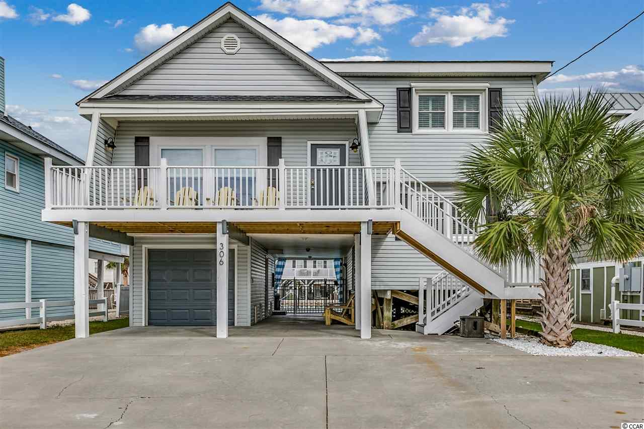 Beautifully updated luxury beach house located on the channel in Cherry Grove.  Just two blocks from the oceanfront in North Myrtle Beach.  Outstanding investment opportunity with almost a decade of solid rental history that well exceeds the area average.  Bungalow 55 has all of the traditional charm that you would expect in a classic southern beach home, but is filled with modern upgrades throughout.  Gloss white tongue and groove ceilings throughout with heavy white beam work add tons of character to the home along with the painted pine bead board on the walls.  The kitchen was upgraded in 2013 with white shaker cabinetry, charcoal gray granite, and glass backsplash.  Bathrooms were updated as well with floor to ceiling white subway tiles, glass mosaic floors, new vanities, and comfort height toilets.  All plumbing lines and fixtures were upgraded and replaced as well.  Luxury vinyl plank Core Tec flooring has just been installed throughout in a distressed, hand scraped style.  To add a further modern touch, all door hardware and lighting has recently been changed to matte black.  The home features modern furnishings and is sold completely furnished and includes everything!  Fully turnkey as a vacation rental or second home.  The floor plan of this property is unique to the area and is a split level.  The main floor is raised with an open kitchen, dining, and living area.  Two bedrooms and bath are just a short flight up and two more bedrooms and bath are on the lower level.  The ground floor has a laundry and storage space with garage and pedestrian door for entry.  Installed in 2014, the outdoor space features a 21 X 25 fiberglass pool with paver patio surround and a fully fenced backyard.  A new vinyl wall bulkhead was installed as well.  Further features included keypad entry to all doors with wireless access, new Trex decking with vinyl railing, gabled roof was installed in 2010, and new HVAC was installed in 2010.  All windows and exterior doors were replace