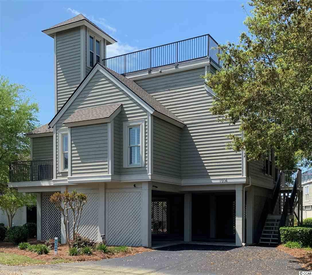 This beauty is priced to sell. Such a bright and cheerful surrounding. This is a 2nd home and never used as a rental.  This 3 BD, 2 BA has house top views of the waterway, 17th green and 18th tee!  Upgrades include:  new roof in 2017, plantation shutters, smooth/flat ceiling throughout the house (no popcorn), new replacement windows and doors throughout (with UV film to block heavy sunlight), new carpet in bedrooms. The rest of the home has tile and pergo wood flooring.  HVAC is approximately 7 years old.  Home includes all major appliances, window treatments & washer/dryer (side by side).  Most furniture is negotiable.  Located in an upscale, gated community with all the amenities one could ask for: fitness center, two clay tennis courts and two asphalt courts, private owner's pool with spa, community pool for tenants & guests, special golf rates. An ocean front cabana for owner's use is included in this package. This removes parking concerns/issues for those beach trips. No golf carts or motorcycles allowed in Tidewater.