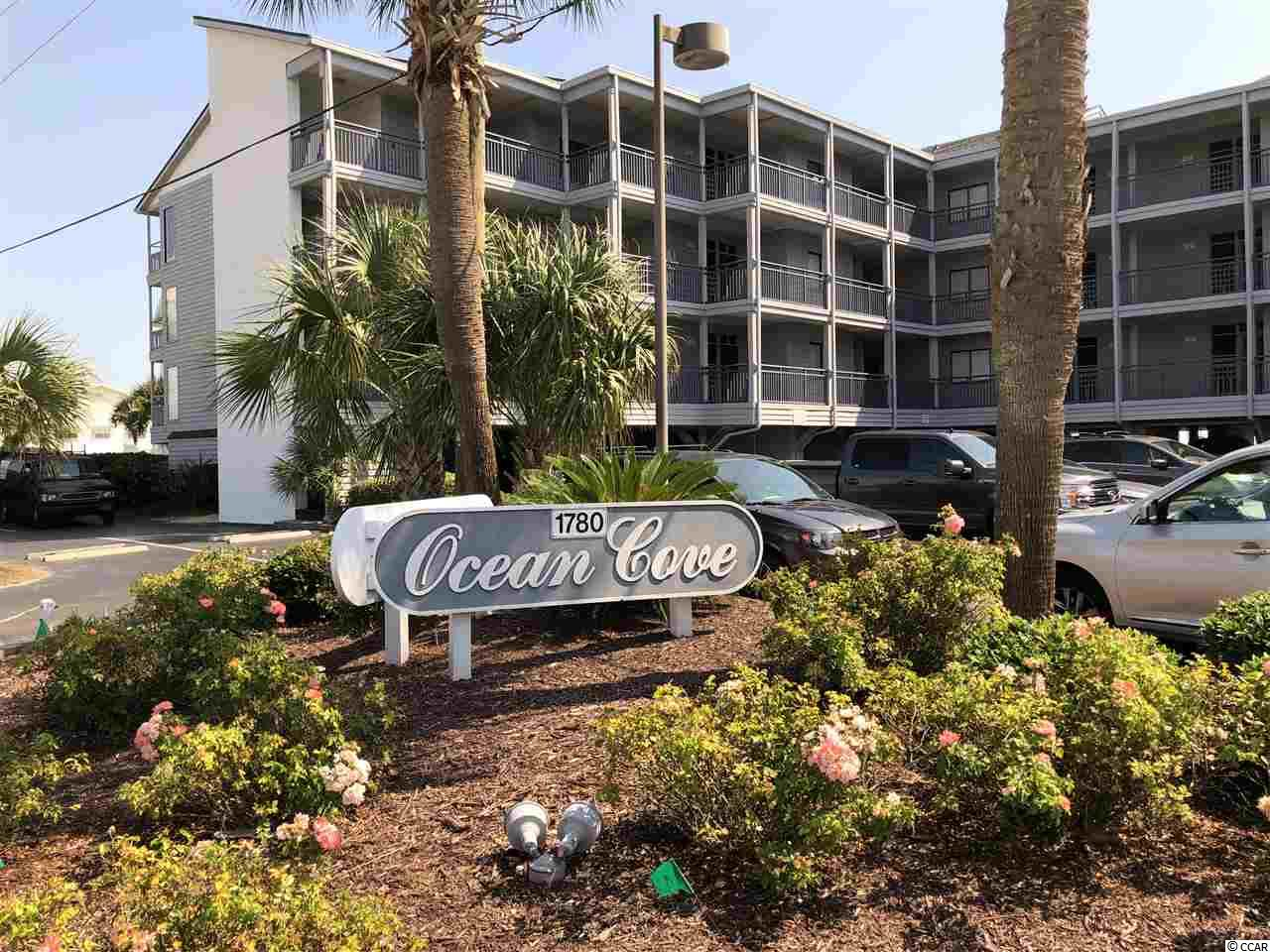 Located on top floor. A large skylight brightens the condo. New water heater. Full size washer & dryer in separate room by condo entrance replaced less than 2 years ago. Owners closet in unit. 2 balconies with ocean views, one is screened. Square footage is approximate and up to the buyer and buyer's agent to verify. Ocean Cove is a complex much in demand, with a beautiful pool and hot tub.