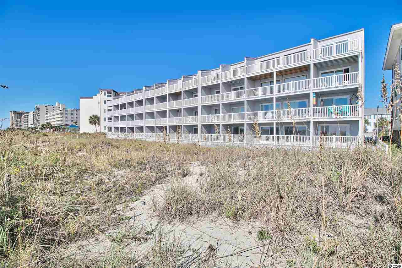 COME SEE THIS PERFECT BEACH GETAWAY AT THE BEACH! THIS FIRST FLOOR, OCEAN FRONT STUDIO IS READY TO MOVE IN. NEWLY UPDATED KITCHEN CABINETS, NEW REFRIGERATOR, NEW MICROWAVE, AND ALSO NEW ALL IN 1 WASHER/DRYER. ENJOY THE WONDERFUL OCEAN BREEZE LOUNGING ON YOUR 8 X 12 OCEAN FRONT BALCONY OR SUNBATHING ON 1 OF THE 2 SUN DECKS SURROUNDING THE LARGE SWIMMING POOL! BUILDING HAS METAL ROOF AND LOW HOA DUES.