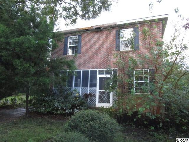!REDUCED!  Brick home!  5BR/2 BA 2-story home in beautiful  Georgetown, SC. Great proximity to schools, shopping, churches, local boat landings, rivers and the beaches! Perfect primary residence, vacation home, or rental. 5 bedroom, 2 bath home ready for your personal touch and featuring LARGE bedrooms, yard fencing, a spacious kitchen, office/nursery or flex room downstairs near the front bedroom, efficient floor plan, screened front porch and covered rear porch. Public water and sewer. Close to recreational boating, and all the historic charm of Georgetown, SC.