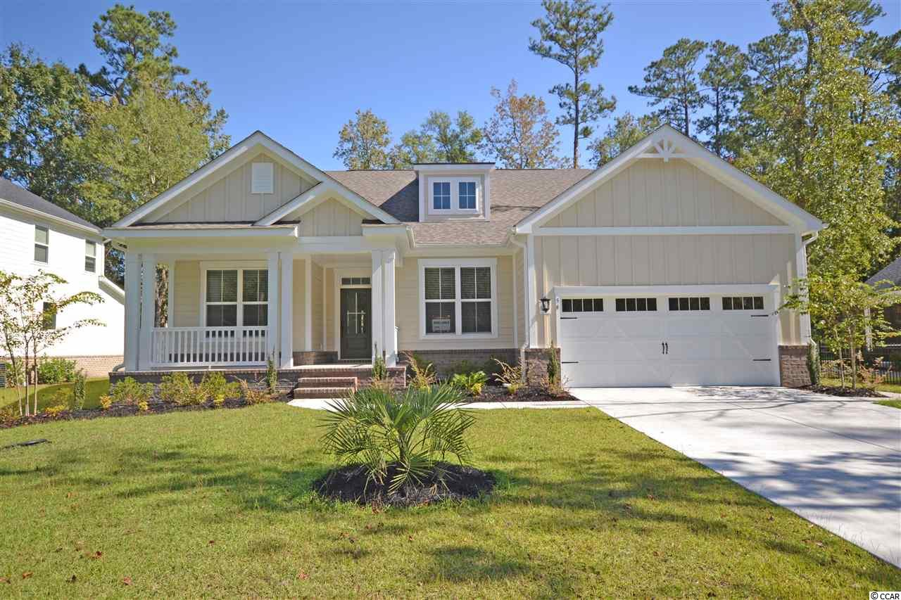 Just completed and move-in ready home in desirable Litchfield Plantation.  This large home is nearly 3100 htd square feet and offers an open floor plan with gracious sized rooms.  The gourmet kitchen offers beautiful quartz countertops, raised height cabinets with soft close, pot filler over the gas cooktop with hood, large pantry, wine rack, glass cabinets and kitchen island seating!  The spacious great room has a gas fireplace, vaulted ceilings and beautiful built-in cabinets and shelving.  The 19x16 master suite offers a huge walk-in closet opening up to the laundry room and large tiled shower.  The downstairs has 2 additional bedrooms and study.  Upstairs is a massive gameroom/4th bedroom and bathroom.  Hardwoods throughout the main living areas and master bedroom.  Other notable features of this 100% energy efficient home include coffered ceilings in the dining room, blinds throughout, gutters, back porch, and so much more! Litchfield Plantation is a historic community overlooking the ricefields out to the Intracoastal Waterway/Waccamaw River.  Residents enjoy a pool and clubhouse overlooking with scenic views, the Avenue of Live Oaks lined with centuries old, moss draped oaks leading up to the historic Plantation house, use of the community beach house on Pawleys Island, community marina and so much more!  Litchfield Plantation is located close to area schools, shopping, fine dining and more!  Just a 70 mile drive to spend the day in charming Charleston, SC or 25 miles to the attractions of Myrtle Beach.