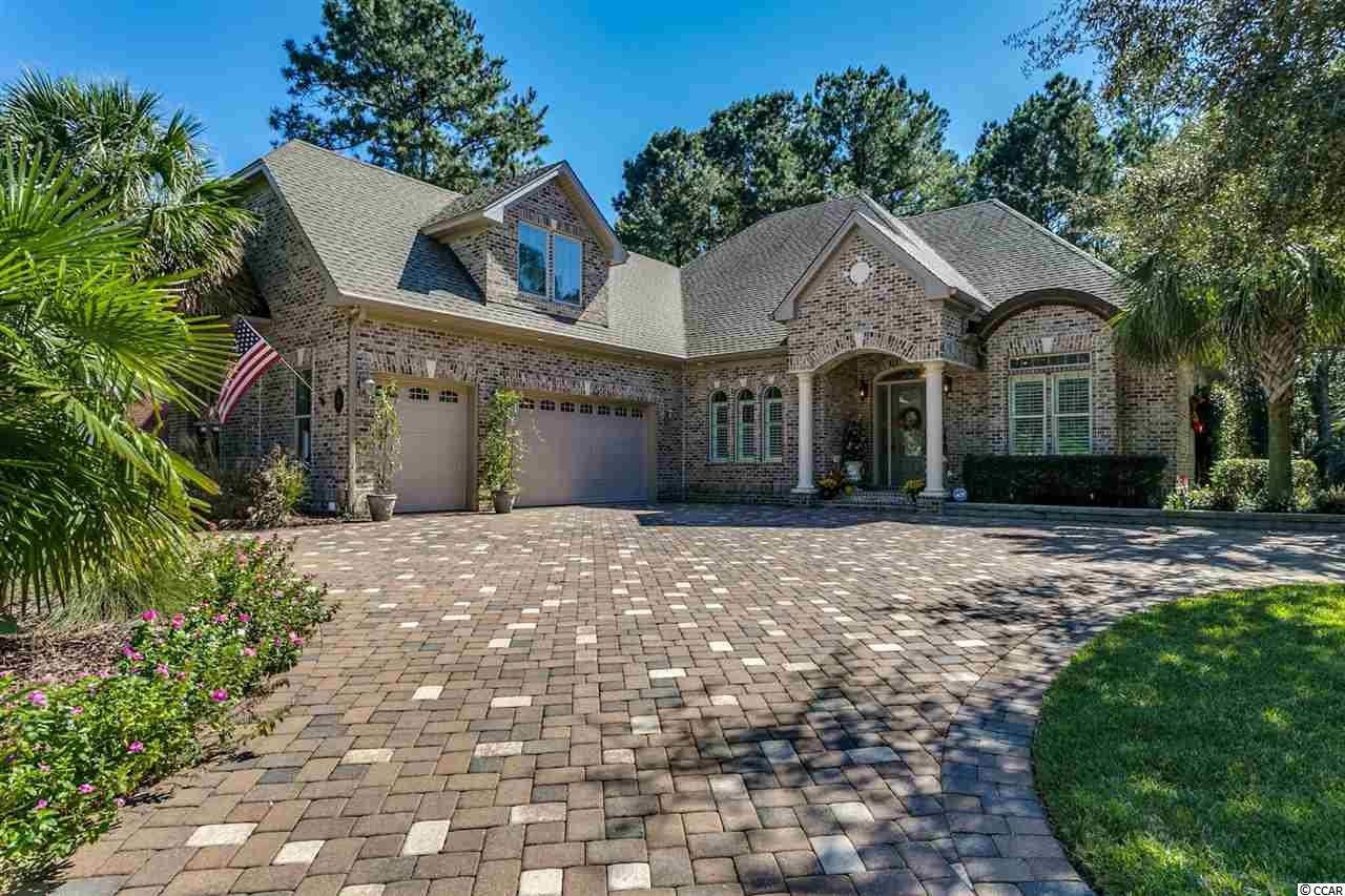 "Pristine and Spectacular!  Custom Built with First- Rate Quality Craftsmanship, this All- Brick, 4 bedroom 3.5 bath Home displays Pride of Ownership throughout. Situated on a secluded corner lot, Live Oak trees, Giant magnolias, fresh water ponds, marshes and wetlands are bountiful at Heritage Plantation. The plantation offering only 512 home sites on the sprawling 637 acres, privacy and a congested free life style is afforded to all property owners. The amenity package available to all property owners leaves little to be desired. Access for owners and their guests at a spacious Owners Club house with a pool, hot tub, fitness area, playground and 4 HarTru clay tennis courts are included in your yearly homeowner's dues. Also inclusive of your homeowner's dues is access to a spectacular Intracoastal Waterway marina and a large social area with a full time dock master. Also wet and dry dock storage options. Heritage Golf Club is ranked among the ""50 Best Public Courses in America"" by Golf Digest.****  The Four Season Room has its own set of Floor to Ceiling Windows, with the beauty of the surroundings. Allowing lots of Natural Light to flow into this impressive home. This room also adds elegance with its 16 ft. ceilings and granite fireplace. An adjoining Great Room divided by a 9 ft. sliding glass pocket door to open both rooms to a grand open space to enjoy. This room embellished with Custom Built-Ins with a travertine fireplace and triple tray ceiling with rope lighting for evening enjoyment. Beautiful porcelain tile flooring thru-out the main floor. Entertaining and cooking is a Pleasure in the Well-Equipped, Designer Kitchen. With Thermador appliances, Custom Crafted Soft-Close Cabinets, Granite Countertops, Travertine and Glass Back Splash, Large Island and Walk-In  Pantry,  Breakfast Bar and Breakfast Nook. Plus a Wet-Bar with sink and Wine Frig. The Formal Dining Room invites guests to enjoy the detail on display that includes custom moldings, Plantation Shutters. The Master Suite, provides an extensive custom Walk-In Closet and the Master Bath offers Double Sink/Vanities, impressive Walk-In Tiled Shower, with Therapeutic Tub for relaxing . The Main Level also provides an attractive, Laundry Room with numerous Cabinets, and a well-positioned Half Bath. Large Walk-In Closet below the Exquisite stair case above, and a 3 Car Garage, with slat wall for organizing. The Upper level  features additional Bed Room or In-law Room with Full Bath. As well as a Bonus Room ready to be made into your very own Theater –Room. Also a conditioned Walk-In Attic space. ****  Additional information on the unbelievable construction quality:   *Bluwood building materials, which protects against mold, mildew and termites  *Elk 160 MPH shingles with Grace Tri-Flex synthetic underlayment  Closed Cell Spray Foam Insulation for airtight fortified construction  *Tankless propane hot water with recirculation heater and pump  *Four Zone Trane 19 Seer HVAC with separate humidity control unit  *Impact Plus Low E Glass and Transom Windows throughout  *Central Vacuum System, Central Intercom, Multi- Room Audio System, Theater Surround Sound System, Cat 5- Wiring  *10 ft. ceilings with 8 ft. solid construction doors  *Rope lighting in tray ceilings with crown molding throughout   *Bull nose corner bead and custom wood shelving in all Closets  *Outside features Multi colored Paver Driveway, Walkway and Two Level Raised Paver Patio. Retractable Remote Patio Awnings  *Landscape Lighting System (12 volt), and 29 nozzles Insect Spray System   *A Tri-Level Waterfall, Micro Irrigation for shrubs and plants, raised flower beds with lots of perennial flowers  *500 Gallon in ground Propane Tank with connections for grill and electrical components installed for a future generator."