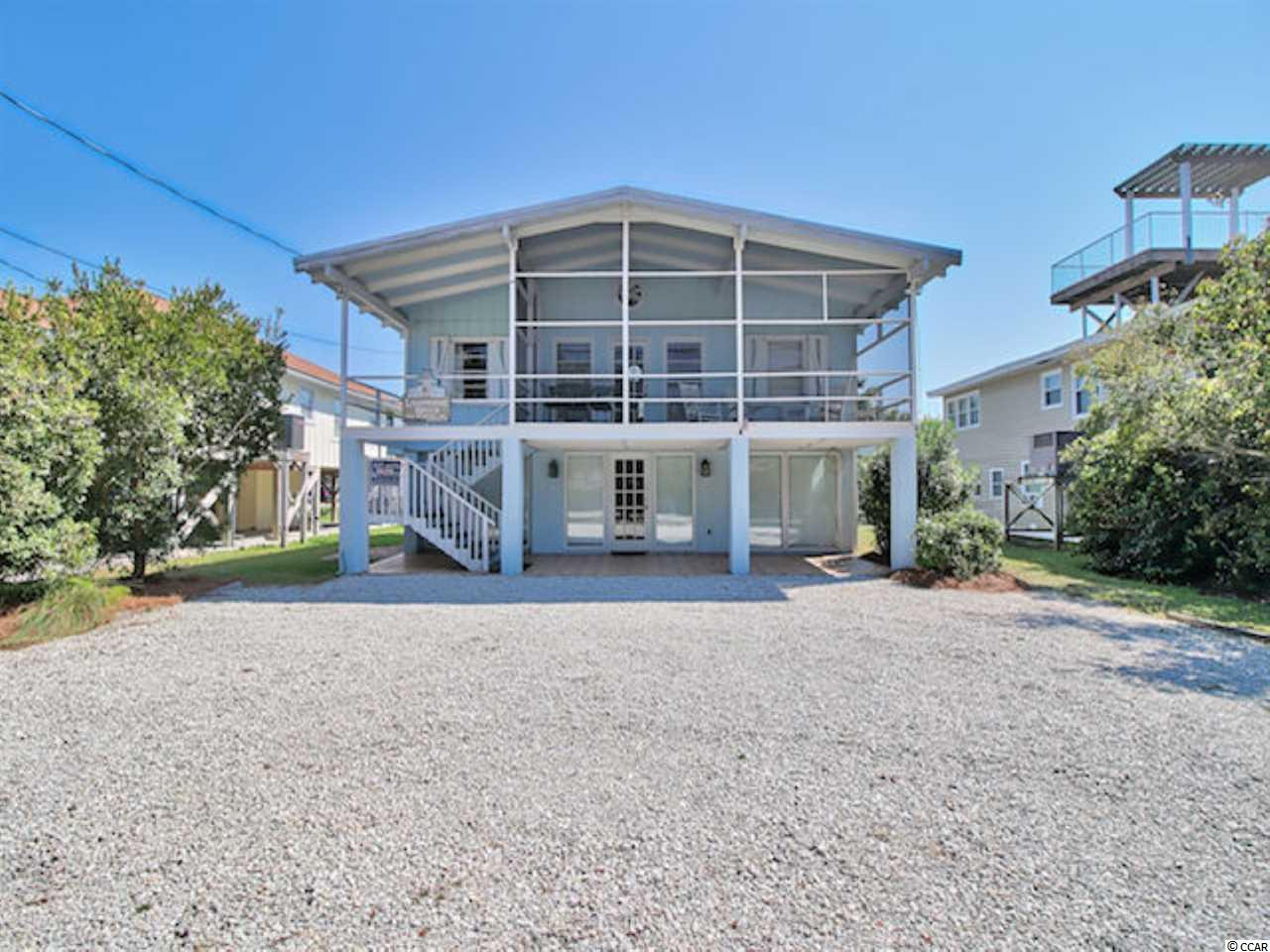 An amazing 7 bed, 4 bath home with a private heated salt-water pool, just yards from the beach in Pawleys Island! The upstairs living quarters features a spacious open living and dining area with high ceiling and tons of natural light, a vast relaxing screened porch with ceiling fan, a sizable open kitchen and 4 bedrooms that share 2 full baths. The first-floor level includes another open living space, a second large kitchen, and 3 bedrooms that share 2 full baths. The unique Widows Watch style deck on the very top provides a wonderful gathering space with an ocean view. The back yard is fenced for privacy and includes a convenient outdoor shower with hot & cold water. This property has multiple possibilities from a solid investment property or personal home in the upper space and investment rental of the lower space to a complete permanent home with a first-floor mother-in-law suite. The property is just a block and a half from the beach and just minutes from medical centers, shopping, dining, entertainment and all the Grand Strand has to offer!