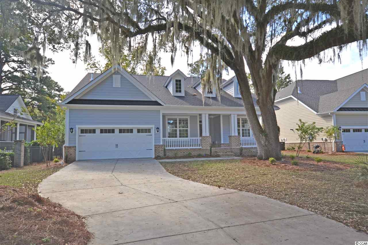 This home is nearly move-in ready in desirable Litchfield Plantation.  Just a few more weeks for completion!  This large home is nearly 3100 htd square feet and offers an open floor plan with gracious sized rooms.  The gourmet kitchen offers beautiful countertops, raised height cabinets with soft close, gas cooktop with hood, large pantry, glass cabinets and kitchen island seating!  The spacious great room has a gas fireplace, vaulted ceilings and beautiful built-in cabinets and shelving.  The 19x16 master suite offers a huge walk-in closet opening up to the laundry room and large tiled shower.  The downstairs has 2 additional bedrooms, screened porch and study.  Upstairs is a massive gameroom/4th bedroom and bathroom.  Hardwoods throughout the main living areas and master bedroom.  Other notable features of this 100% energy efficient home include coffered ceilings in the dining room, blinds throughout, and so much more! Litchfield Plantation is a historic community overlooking the ricefields out to the Intracoastal Waterway/Waccamaw River.  Residents enjoy a pool and clubhouse overlooking with scenic views, the Avenue of Live Oaks lined with centuries old, moss draped oaks leading up to the historic Plantation house, use of the community beach house on Pawleys Island, community marina and so much more!  Litchfield Plantation is located close to area schools, shopping, fine dining and more!  Just a 70 mile drive to spend the day in charming Charleston, SC or 25 miles to the attractions of Myrtle Beach.