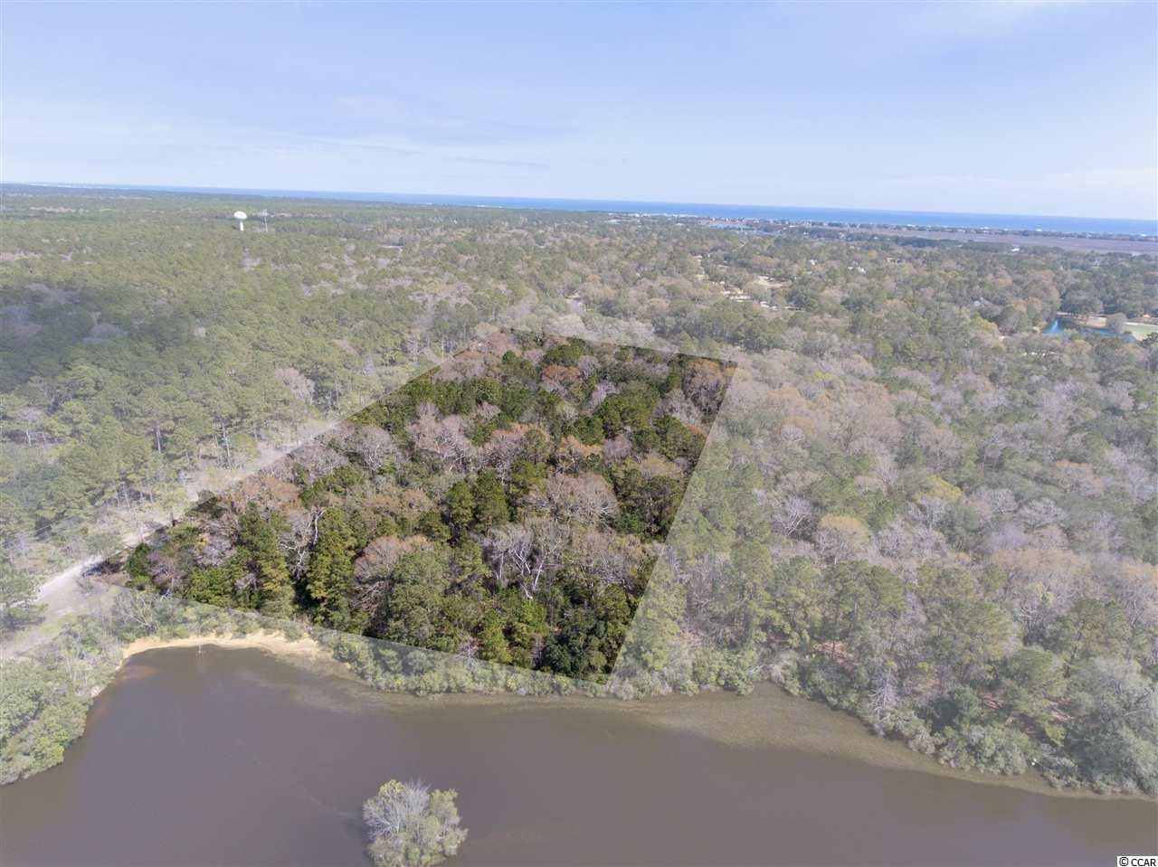 Lake Community Estate Opportunity- Rarely does an opportunity like this present itself for the discerning purchaser. Within DeBordieu Colony, one of the east coast's most unique private communities, lies only a handful of true estate-sized properties. This offering features approximately five acres of lowcountry South Carolina maritime forest bordered by the former Vanderbilt estate of Arcadia Plantation. Along the rear of the property is a large pond separating this estate from its neighbors. Within the privacy of this parcel one has room for a substantial home and guest cottage, pool, tennis court and gardens. Community amenities include private club facilities with dining, golf and tennis as well as beach and boating access.