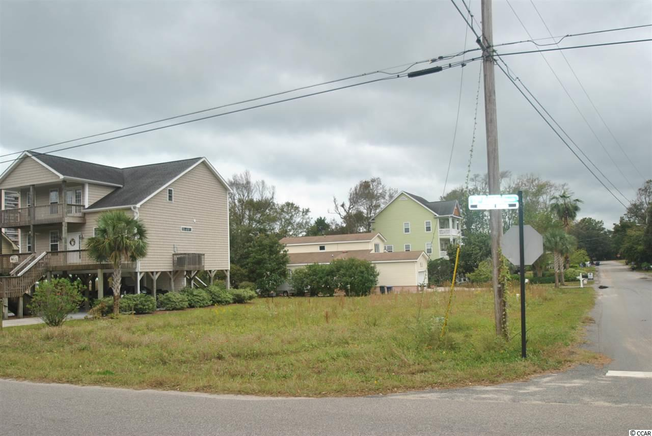Great building lot in North Myrtle Beach. Excellent location for primary residence of rental property. just a couple of blocks off the ocean and an easy golf cart ride to Main Street. This property id NOT in a designated flood zone. No HOA! Buy now, build later.