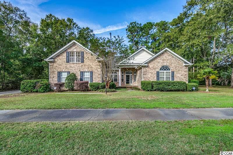 A Ricefields Plantation all brick veneer beauty located on a large corner lot and easy walk to the community pool. You will love the charm and beauty as you walk up to the front covered brick angled entrance way leading to an expanse tile floor foyer overlooking the formal dining room with wainscoting accents. You will notice the 10 foot ceilings, the double crown molding and the triple glass gas log fireplace with tile accent and white mantel. This fireplace offsets the large family room where the tile floor continues throughout. An 8 foot sliding glass door leads to a 14x15 Carolina room with 2 ceiling fans and overlooks the corner side yard. An upgraded kitchen with granite countertops, Samsung stainless steel appliances, white full overlay cabinetry, glass front cabinets above the built in desk area, breakfast bar, breakfast nook plus a living room area with lots of natural sunlight through the transom windows. The Master suite also features transom windows, double walk in closets with pocket doors, large tile floor master bath with double sink granite counter tops, walk in glass shower and large whirlpool tub. Fourth bedroom / bonus is upstairs with full bath and closet area. Additional features include surround sound, large laundry area with cabinet storage, a 26x15 back patio, 2 car garage with built in storage and a detached storage building. Ricefields amenities includes a community pool, a nature trail along the Waccamaw River and a private boat landing.