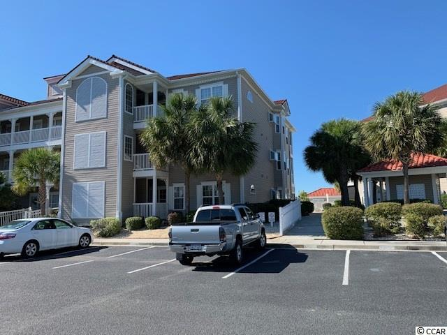 **RARE OPPORTUNITY**- Updated ground floor end unit 3 Bed/2 Bath with enclosed porch area that has been incorporated in the great room/living area of unit so there is a continuous flow throughout the unit (created additional living space 6.4 x 21.10 with ceilings two ceiling fans ) All stainless steel appliances, no carpet in this unit, tile and light color laminate flooring which makes the unit very bright. Master bedroom has large walk-in-closet. Kitchen has been completely upgraded cabinets, counter tops, appliances and tile flooring. Split floor plan, small attached utility storage closet. This unit is furnished and is located minutes from beach, shopping, restaurants, entertainment, golf and steps away from pool  Talk about convenience. All measurements and square footage are approximate and not guaranteed.