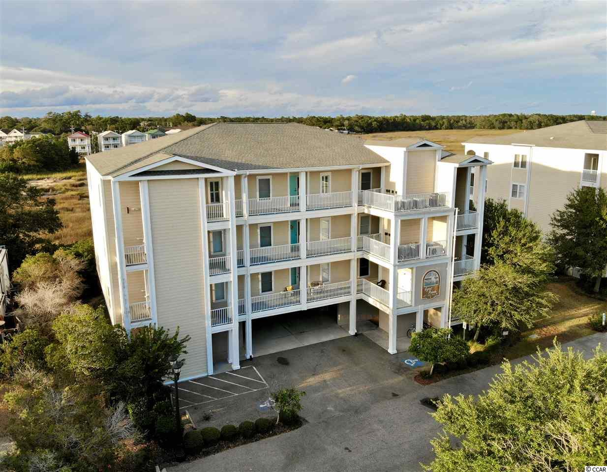 Impeccable 2 bedroom 2 bath condo in Egret Pointe South in Cherry Grove, only a golf cart ride from the ocean! This fabulous top floor, elevator access, end unit condo is being sold fully furnished with all appliances conveying! Beautiful and practical tile floors, that have the look of hardwood flooring, run throughout living, dining, and bedrooms. Some other charming features include plantation shutters on every window and crown moulding throughout most of the unit. The floor plan is very open and the main living space has a nice flow. The living room is spacious with a gas fireplace and sliding glass doors leading out to the screened porch overlooking the marsh! The living/dining area also has a dry bar with arched detail and shelving. In the kitchen you will find updated stainless steel appliances, a pantry, a lovely tile backsplash, and a large breakfast bar. The master bedroom has an ensuite, tray ceiling, walk-in closet, and its very own gas fireplace! The second bedroom is good sized fitting a double and twin bed plus it has a roomy walk-in closet. This bedroom has its own full bath as well but this bathroom is also accessible by a door to the main living space. This great unit would make a fantastic vacation home or investment property! This unit has a very spacious parking space under cover of the building, golf cart parking, and a storage closet by your parking space. Egret Pointe South is a quiet community with a pool, just a couple of minutes from Cherry Grove Beach!