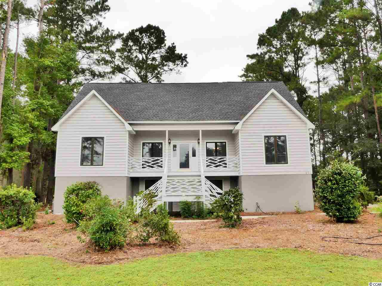 Private beach access, Soaring Ceilings, an abundance of natural light, and breathtaking golf course views. These are just a few of the words used to describe your new home in The River Club of Pawleys Island. Situated only a few yards from the 17th tee box, 49 Fairway Lane boasts more than just a pretty view. Recent renovations include a new luxury level kitchen with all new stainless appliances, updated bathrooms, hardwood flooring, new carpet in the bedrooms, updated fixtures, and so much more. In addition, the ground floor area houses a full guest suite that could also be used as climate controlled storage, a game room, or even a man-cave. The River Club is a well establish gated community offering private beach access through Litchfield by the Sea, Tennis, Pools, Golf, and much more.