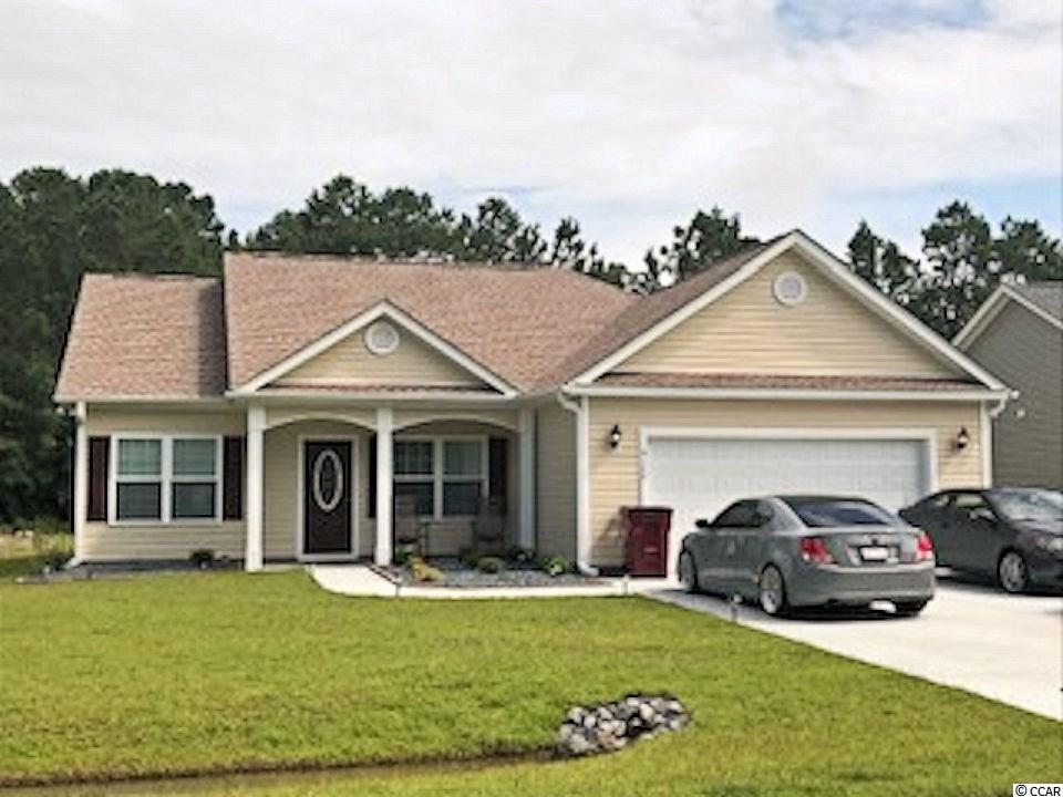 "NO HOA, large home sites! Beautiful and popular Pecan Alt 2 plan has open living areas, split bedrooms, front porch and large rear screened porch. Living area has vaulted ceiling, ceiling fan with light, spacious dining area, large kitchen with lots of solid wood custom cabinets with crown molding and knobs, stainless steel appliances, including gas stove, refrigerator, wrap around breakfast counter and pantry closet. Master bedroom has vaulted ceiling, fan with light, large walk-in closet, 5' walk-in shower and raised height vanity with 2 sinks and a linen closet. Split bedroom floor plan. Carpet in all the bedrooms and upgraded wood look waterproof luxury vinyl plank in living area, dining area, kitchen and hall, vinyl floors in the bathrooms and laundry room. Rinnai tankless gas water heater, gas heat. Upgraded interior trim includes 3 1/4"" casings and 5 1/4"" baseboards. Low E glass windows, energy efficient homes. Boat and RV parking allowed. Spacious finished/painted 2-car garage, with automatic door opener, pull down stairs to attic storage above. Irrigation system, gutters, sodded and landscaped yard. Natural gas community. Close to International Drive, quick/easy access to Myrtle Beach. Basic Restrictive Covenants. Photos and video are for illustrative purposes only and may be of similar home built elsewhere. Square footage is approximate and not guaranteed. Buyer is responsible for verification."