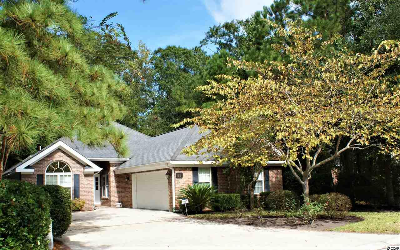 "Have you been searching for a 3 bedroom home in a gated golf course community in Pawleys Island east of 17  that won't break the bank? Then the house you've been waiting for is now for sale!  Welcome to 99 Pintail Ct located on a quiet cul de sac in the highly desirable community of Pawleys Plantation. This gorgeous 3 bedroom, 2.5 bath home has been a vacation home for years and  has had minimal use. Now that the kids are grown, it's time for this owner to downsize to a condo.     The great room has a beautiful set of french doors leading out to the patio area. You'll notice that this home is designed for indoor and outdoor living! A striking feature of this room is the corner gas fireplace with blower with a flat screen TV above it. The TV will convey with sale too!  2 huge skylights in the vaulted ceiling flood the room with natural light and a ceiling fan  in this room and all bedrooms keeps the house comfortable year round. The dining area features a tray ceiling and chair rail and is adjacent to the great room.  It can comfortably seat 10 people and have room for  buffet or china cabinet if desired.  The Guest bedrooms are located off the great room, with a pocket door for added privacy and share a hall bath. At the back end of  the home is the Master suite which includes a large walk in closet with custom designed fittings and a generously sized master bath with a spa tub, separate shower and dual vanity. The master features a sliding glass door that opens to the patio area.   The eat in kitchen is  huge and boasts white cabinetry and granite counter-tops and white appliances. The sliding glass door opens to the screen porch and patio beyond.  The laundry closet and power room are in the hall leading to the garage. The refrigerator, washer and dryer will CONVEY with the sale, without warranty. A neutral tile floor blends nicely with the overall neutral color scheme you will find throughout. The kitchen has been wallpapered but it is the only room in the entire house that is. It's easily removed, if desired. This lovely home is over 1500 sf heated BUT, it also includes a huge 2 car garage that is both heated and cooled on a separate system!  Ideal for the hobbyiest who wants a comfortable setting to enjoy working on hobbies, or using the space as a ""man cave"" perhaps. There is also a staircase leading up to the attic over the garage offering tons of convenient, easy to access storage space.    Out back overlooking the wooded area is large tiled screen porch which is a MUST HAVE in our ideal climate. Beyond you will find a huge paver patio with a pony wall  that will accommodate a large group of friends to enjoy the propane ""firepit"" on those cool winter evenings!  It is the IDEAL setting for entertaining family and friends. Yes, the firepit will also convey! This is a low maintenance yard with underground sprinklers. Vacant lots on either side of this home. Talk about privacy!  Pawleys Plantation is one of the few gated golf course communities east of 17. It is set amongst 200 year old Oak trees in one of the most idyllic setting you will find on the Grand Strand. The community includes a Jack Nicklaus designed championship 18 hole golf course, a world class driving range, Clubhouse, pro shop, pool, and tennis courts. Come and see for yourself. This home, this community, will not disappoint."