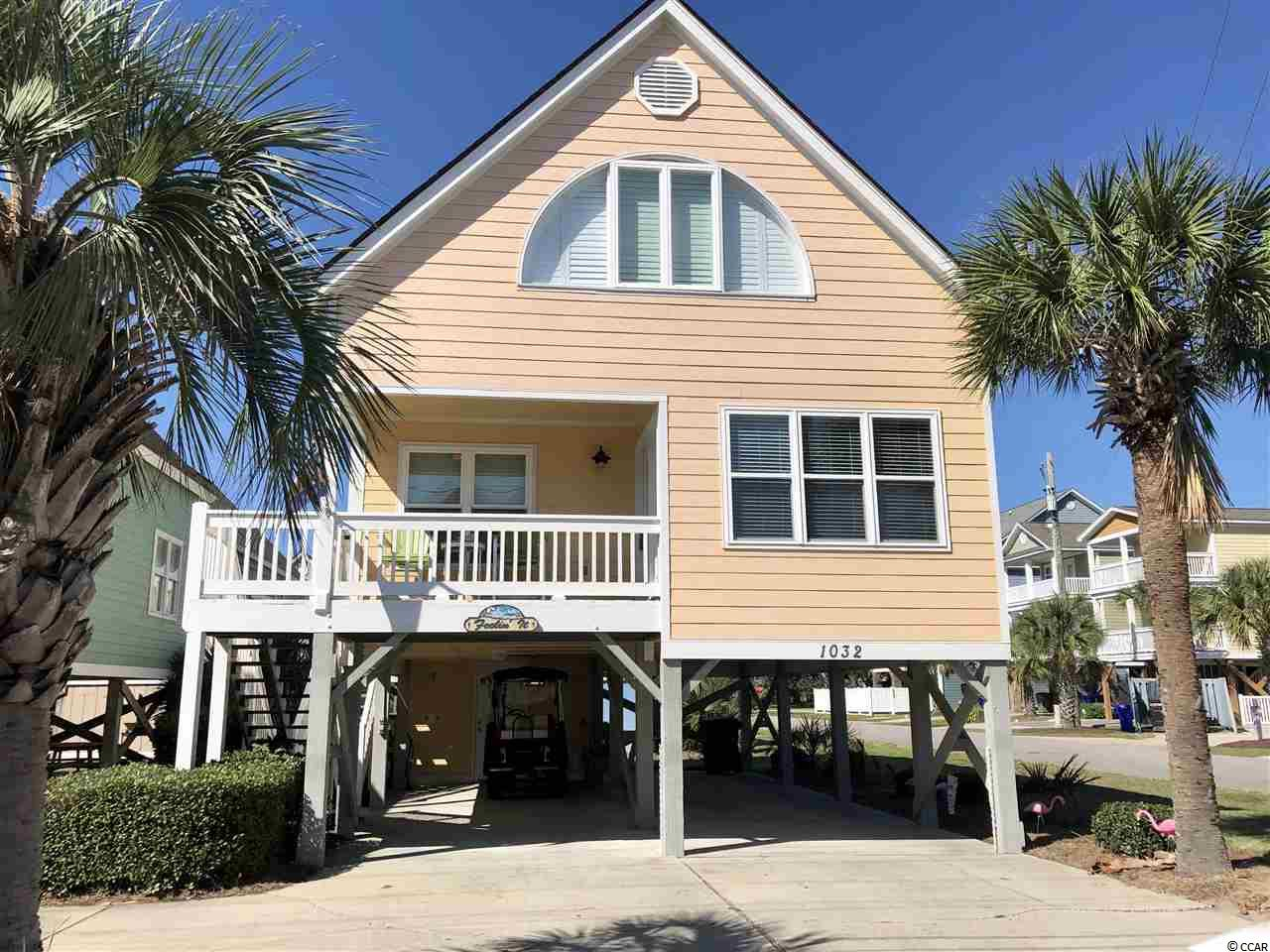 If you are looking for a beautiful beach house, being sold fully furnished in the heart of Surfside Beach, this is it!  Enjoy the ocean view from your balcony and walk right across Ocean Blvd to enjoy a day at the beach!  This beautiful raised beach house in the Sea Bridge subdivision is perfect for a second home, investment property or your primary home!  Featuring 3 bedrooms and 2.5 baths with an additional space upstairs that could easily fit two twin beds or be used as a sitting area, office or whatever you would like it to be!  The master bedroom is conveniently located on the first floor!   Some of the updates include new carpeting, plantation shutters, HVAC, tiled showers, TV's & siding!    Plenty of space under the house for 4 cars and you can store your golf cart in the attached garage space.  Don't forget to take advantage of your community pool and all the shopping and restaurants Surfside Beach has to offer!  Square footage is approximate & not guaranteed. Buyer is responsible for verification.