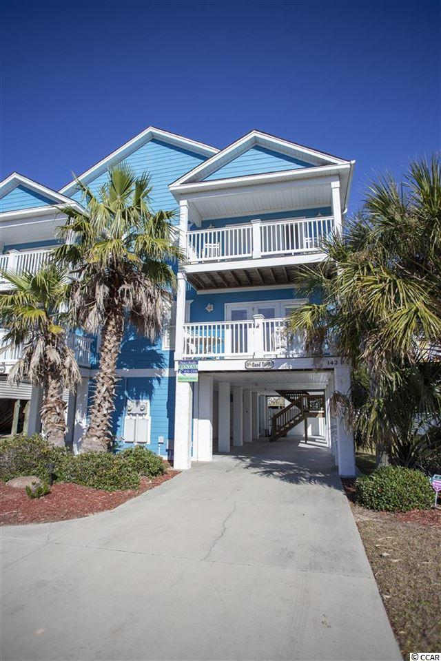 "Turtles dig the dark and you will dig the sunshine and sandy beach at your new home, the ""Sand Turtle."" This home offers the perfect vacation or primary home or make it available to rent and let others enjoy the beauty that this home offers. There is a large storage area downstairs to hold all of your beach toys. The home is beautifully upgraded with wood and tile flooring throughout. You will be amazed at the space of the open concept kitchen, dining room and family rooms.  Ceiling fans are located throughout the home and the family room has modern recessed lighting. This home has been freshly painted.  The dining area has a table that seats four.  Wood cabinets accent the modern appliances and plentiful counter areas in the kitchen for cooking on your nights in. The breakfast bar has added seating with bar stools. The two large couches and coffee table give you plenty of room to relax.  Covered stairs lead up to the bedrooms and attached bathrooms. All of the bedrooms are comfortably furnished with modern beds and include bathrooms and closets for abundant storage for yourself, your family and friends. The home features 2 private balconies, one each on the first and second floors. The balconies can be accessed from the living room and  bedroom on the 2nd floor, providing a beautiful view of the Atlantic ocean! The separate laundry room features full size washer and dryer. Relax by the private pool after a day playing on the beach. In the cooler months you can still enjoy swimming as the pool can be heated. You are only a short walk away from the Garden City Beach pier or a short drive to the famous Marsh Walk restaurants of Murrells Inlet, the ""Seafood Capital of South Carolina.""  This home is the perfect beach getaway with quick access to Myrtle Beach but far enough away from the crowds when you want to relax. Come visit this home today!"