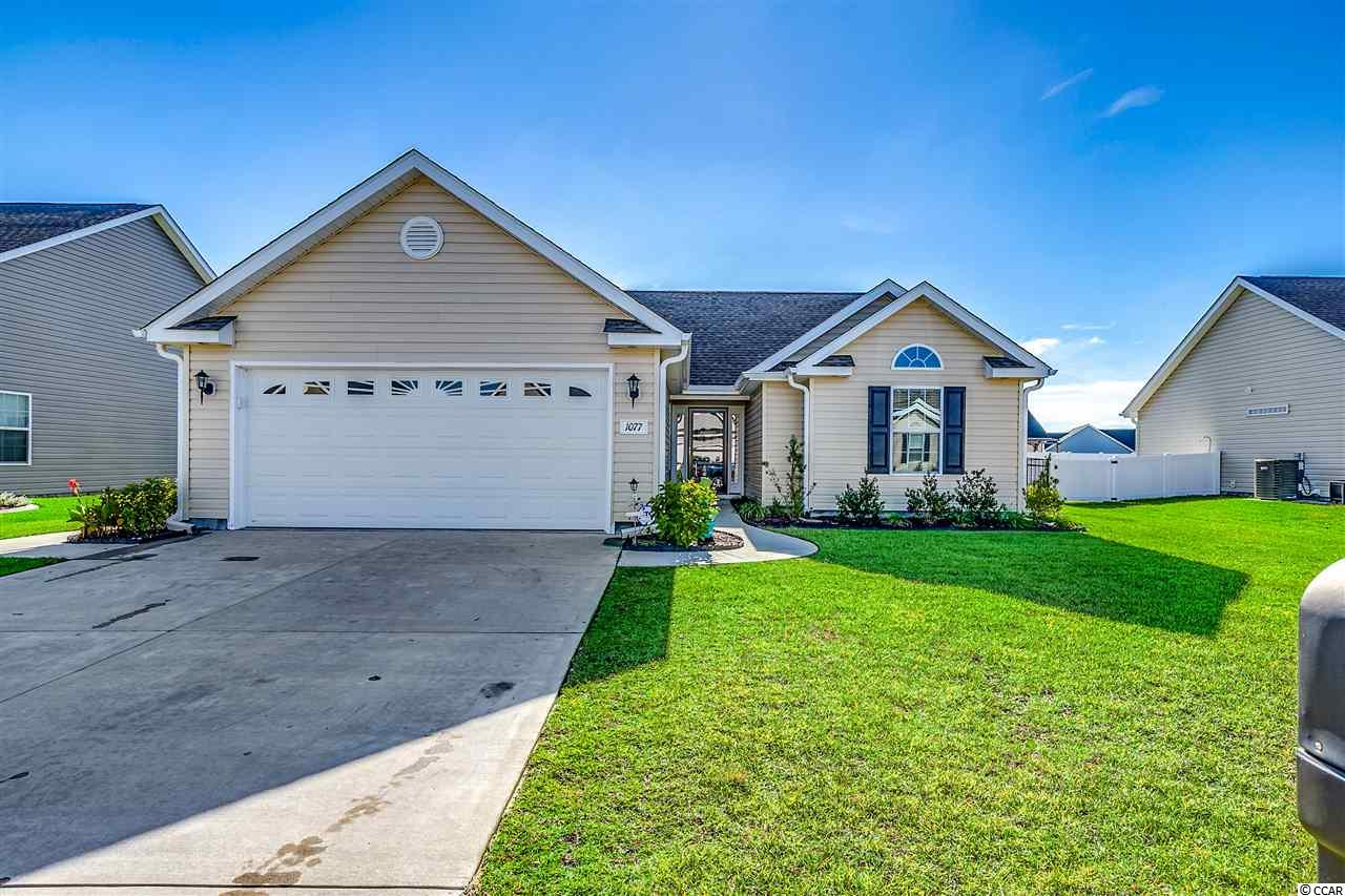 This almost new home was built in 2017. Just a short golf cart ride to the beautiful, blue Atlantic Ocean and white sandy beaches from this wonderful 3 bedroom, 2 bath, 2 car garage home. The vaulted ceiling allows warm natural lighting to flow throughout. The kitchen has excellent cabinet space with fully trimmed, raised panel, richly colored espresso cabinetry and a breakfast nook. The large master bedroom is wonderfully sized with more than ample room for a king-sized bed, bedside tables and other furnishings along with a generous walk in closet. Completely surrounded with black aluminum fencing, the large backyard is the perfect spot for pets or children to play. Just a short ride to Market Common, The Murrells Inlet Marsh Walk or the waterway or leave the car behind and golf cart to the Surfside Pier, water park, public library, dry cleaners, bank, restaurants, grocery, bakery or local ice cream shop. Golf courses, watersports, fishing, entertainment are all nearby. Whether carting to the beach, enjoying the local area amenities, grilling out on your patio or playing a game in your yard with friends or just relaxing on your screened porch, this home is sure to be your treasure. Come find your own place in the sun today! Square footage is approximate and not guaranteed. Buyer is responsible for verification.