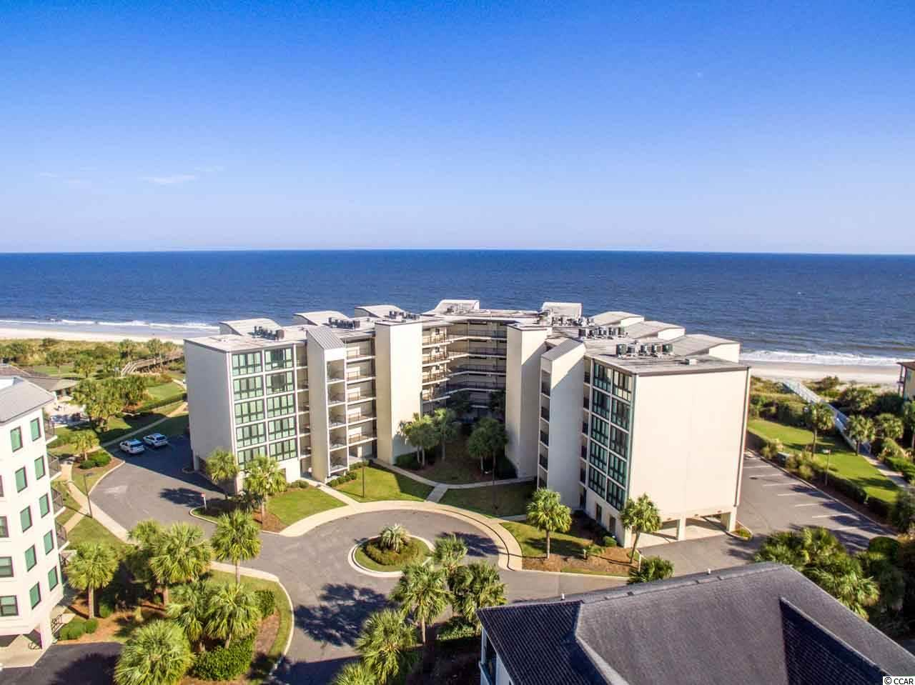 Oceanfront and priced to sell in private resort community!  3 BR, 2 BA in Shipyard Village at Litchfield by the Sea with exceptional views of the beach, ocean and streetscape of Charlestowne Grant. Open floorplan that easily flows from the kitchen, dining and living areas and pours out to the balcony with that allows the ocean and dunescape to feel like a part of your living space! The master bedroom has ample closet space and a charming backdrop of the Charleston style homes in the community's luxury home enclave. The additional guest bedrooms feature hospitality sinks in each. Furnished and equipped as a vacation rental. Litchfield by the Sea is an amenity rich oceanfront community with oceanfront clubhouse, tennis courts, walking/bike paths, crabbing and fishing docks and miles of undisturbed beaches.
