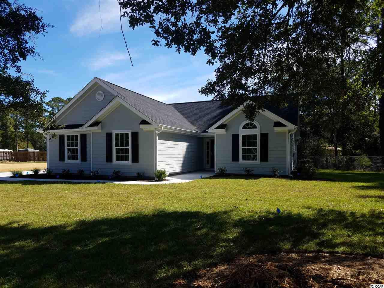 """( Lot 2). You can pick all your selections and colors by getting in early. Welcome home to Murrells Inlet. You are going to see why everyone want to live the """"Inlet Lifestyle"""" This home provides no different. Located a stones throw from Wacca Wache Landing and Marina and, a mile from the Inlet/public boat landing. Wide open floor plan with lots of natural light. 3 bedrooms, 2 bathrooms, 2 car garage, walk-in pantry, and, patio. All upgraded features that will check off every box on your list. NO HOA, large yard, and, plenty room for all your toys. There will be an over sized side driveway for an RV or boat. This will be a very small planned development consisting of 5-6 homes. You need to check this one out before it is gone. This would make an ideal primary OR secondary home."""