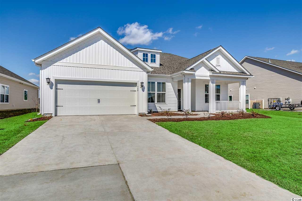 """This lovely Graham-COL (Coastal Elevation) home is located in the boutique community of Belle Mer.  This Graham includes many upgraded features: natural gas range, natural gas water heater, natural gas heat, natural gas grill line off the patio, Stainless Steel Whirlpool appliances (range, microwave over the range, side-by-side refrigerator with ice/water in the door, washer/dryer, and dishwasher), staggered 42"""" Kitchen cabinets with crown molding, cultured marble countertops in both bathrooms, Full Tiled Walk-in spa shower in the Master Bathroom which includes a rain shower head, 52"""" ceiling fans in the great room and Master Bedroom, Mohawk Revwood flooring throughout the living areas and Master Bedroom, and carpet in Bedrooms 2 and 3.  But wait there's more; this Graham also includes a lawn irrigation system, whole house gutters, and window blinds.  All Belle Mer homes are Energy Star Certified.  Amenities Galore: pool, clubhouse, exercise room, sidewalks, and colonial reproduction street lights.  Pictures shown are from a previously built home.  Photos shown DO include upgrades that are NOT included in the home being built.  Call today to schedule an appointment or stop by!"""