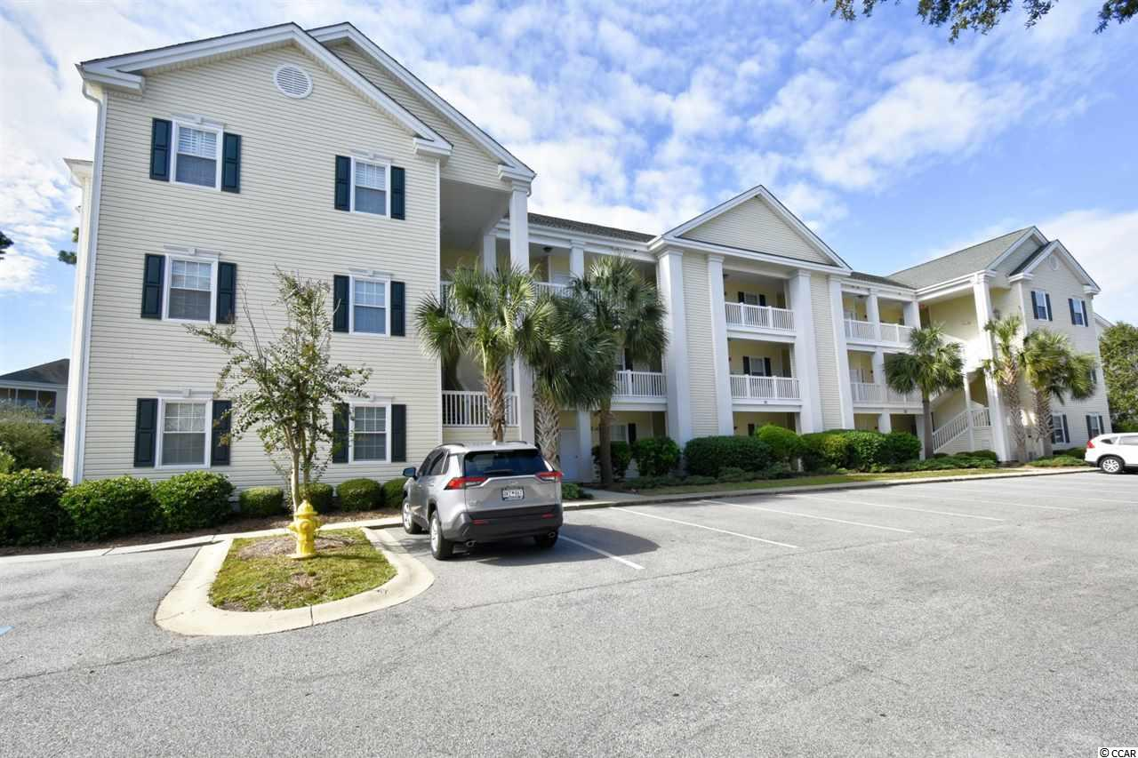 Located in the Gated community of Ocean Keyes, this never rented 2 bed 2 bath end unit comes fully finished with an open floor plan.  The kitchen offers granite counter tops, a breakfast bar w/ extra seating and lots of cabinet space.  Each bedroom is spacious and has ample closet space.  The den could be used as an additional bedroom, office space, movie room or studio.  Walk outside through the french doors & sit your private, screened balcony and relax with your morning coffee.  For all of your additional storage needs, the unit offers an attached storage space.  The community offers 6 outdoor pools, 4 kiddie pools, 6 hot tubs, fitness center, tennis courts, picnic & grilling area and private clubhouses.  Conveniently located to golf courses, dining & entertainment, shopping, area attractions, the Beach & so much more!  Hurry & schedule your showing today!