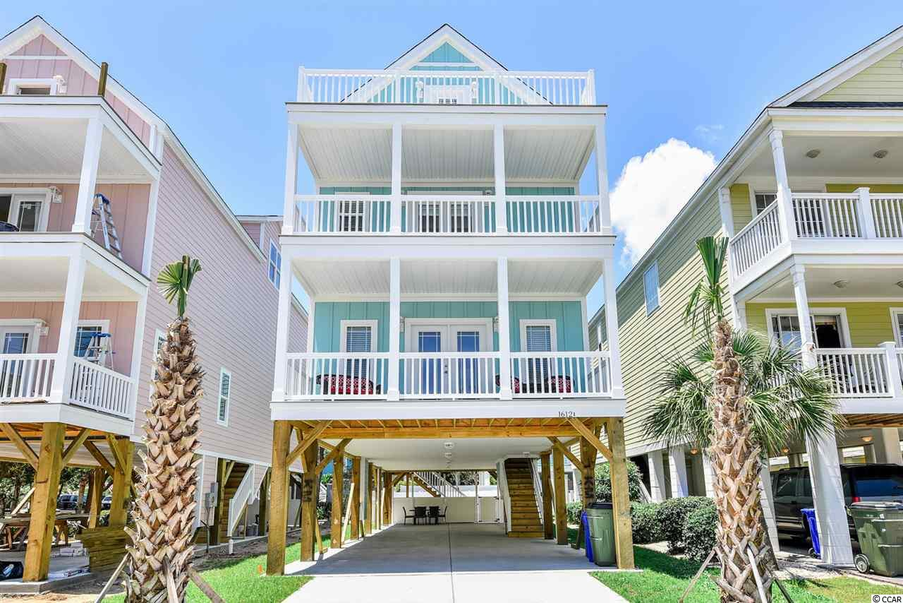 Beautiful Beach Home! Perfect for an investment or 2nd home.  Across the street from a beach access. Private outdoor pool with 4 balconies, 3 of which are covered.  Comes fully furnished and rental ready!