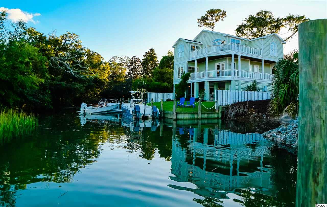 Looking for an anglers paradise, investment opportunity or simply want to live with a million dollar view? Look no further! Your dream home was JUST LISTED for under market and appraised value!  This spectacular home nestled right on the marsh in the heart of Murrells Inlet will have you living that outdoor lifestyle you've always dreamed of living.  This 4 bed 3.5 bath coastal luxury home has it all and was built to last by a local custom home builder in 2008. It's just a short walk, bicycle or golf cart ride away from the famous Marshwalk and all the wonderful restaurants the inlet has to offer. Dock your boat off the sea wall or use the marina next door for no maintenance with deep water access. This large elevated luxury home is built for entertaining. It has a beautiful open kitchen that flows into the family room and is surrounded by glass, decks, and a million dollar view. The main floor has a beautiful dining room with big windows and a sliding door to deck.  The Master Bedroom was built with views and luxury in mind. It has 3 extra bedrooms for the all the guests who will want to come share your piece of Inlet Paradise. Call to schedule a Private showing!
