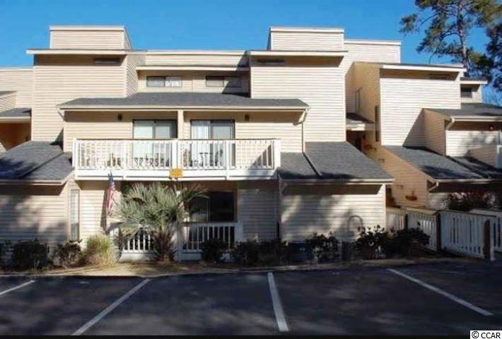 What a view from the balcony over looking the Marsh and The Dunes Golf Course.  This 3 bedroom 3 bath is being sold furnished and has lots of spacious room for a primary residence or a second home.  The living room has vaulted ceilings and a fireplace to enjoy while over looking the beautiful marsh view. This condo has views from two of the  bedroom balconies overlooking the marsh and golf course as well as the living room and dining room balconies.  This unit is within walking distant to the beach or you can enjoy a golf cart ride to the beach and local restaurants in the area.  You can enjoy the community pool that over looks the marsh view as well.  Perfectly situated right on the marsh, near all the Grand Strand finest dining, shopping, and entertainment attractions, and golf courses.  Square footage is approximate and not guaranteed.  Buyer is responsible for verification.