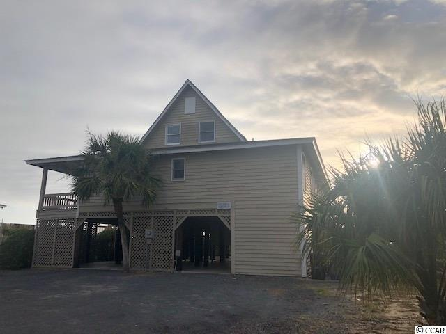 Don't miss your chance to enjoy 4 weeks per year on Beautiful Pawleys Island in this Oceanfront 4 BR 3 Bath home close to Pawleys Island Pier and 2 blocks form the public boat landing. Relax on your Pawleys Island Hammock out back on the screened porch. Feel the cool  ocean breeze from the Back Deck and Sip on a glass of wine in the evening from the Walkout and Seating overlooking the mighty Atlantic. Take a stroll down the beach at sunrise, Surf, Kayak or surf-fish on the point. Cuddle up inside and kindle the fire while creating winter memories too.The possibilities are endless and you share in the cost with other owners in this Fully Furnished Piece of Paradise! Modern Kitchen and lots of room for your family. Tons of parking and owner storage/ locker area underneath as well as a fish cleaning station & outdoor shower after a day of sunbathing on the beach. Sleeps 10 with Two master BR's. Just bring your clothes & groceries and start living the Beach Life today!