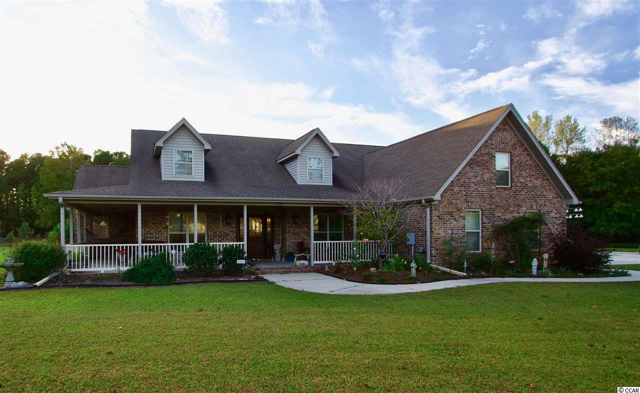 Follow the long gravel driveway to this beautiful custom built home which includes 5 bedrooms, 3 bathrooms with two loft bonus rooms, Carolina room, laundry room, attached two car garage plus its own detached multi-car garage and workshop, walk-in attic for even more storage and swimming pool on almost 2.5 acres of land.  Home is located in a quiet and friendly neighborhood far enough to give you privacy and comfort away from everyday life but also minutes from amenities, major highways and Downtown Conway for your own convenience. The inviting foyer leads to a large and cozy living room with access to a bright and sunny Carolina room.  Gourmet kitchen features quartz countertops and extensive workspace, kitchen island with its own ceramic sink, lots of storage space in the custom hardwood cabinets throughout the kitchen and an informal dining room overlooking the pool and yard through bay windows.  Master bedroom includes its own spacious master bathroom featuring a walk-in shower and jacuzzi garden tub plus access to the patio from the master bedroom. Every bedroom has plenty of natural light and spacious closets. A unique feature about this home is the large 1900+ square feet heated and cooled detached garage which includes its own car lift, boat storage, and detailing bay plus its own bathroom, shower and recreation room: making it the perfect oasis for a car or motorcycle enthusiast! Finally this home boasts of lush and well-manicured land including access to its own above-ground swimming pool and pool deck.  Don't miss out on amazing home and schedule your own private showing soon!